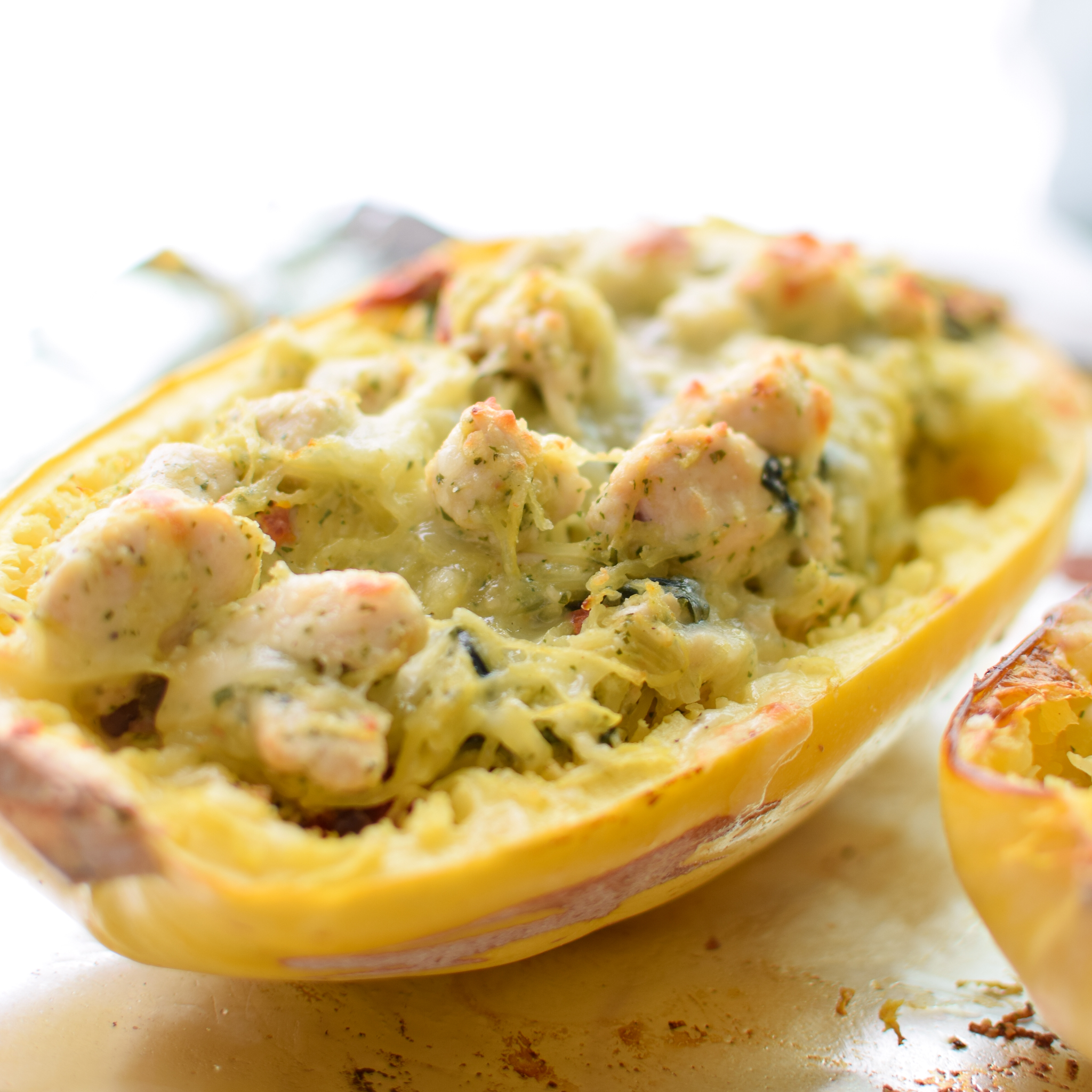 Pesto Chicken Stuffed Spaghetti Squash - Pesto, chicken, spinach, and a little greek yogurt for creamy goodness! Super healthy dinner for two! - ProjectMealPlan.com