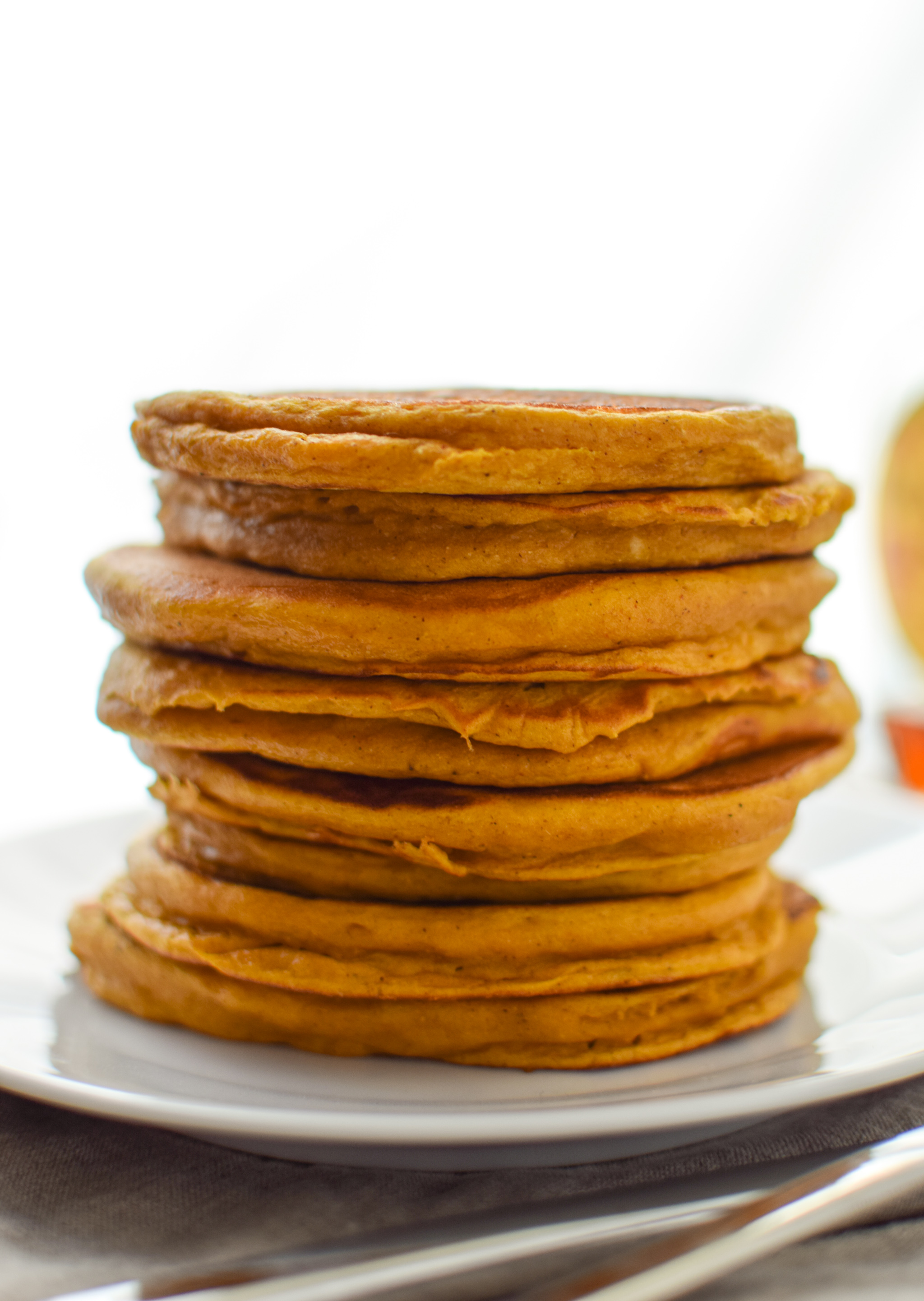 A stack of Pumpkin Pie Greek Yogurt Pancakes.