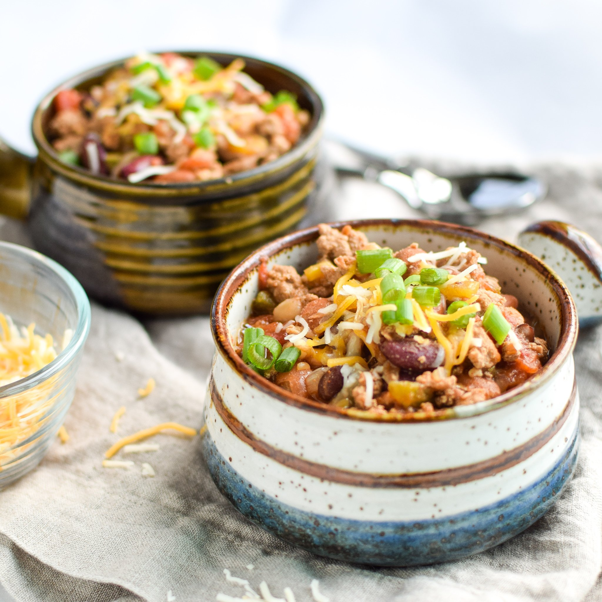 Easy Slow Cooker 4-Bean Turkey Chili recipe - A slow cooker classic that should be in everyone's cookbook! A hearty bean and turkey chili with some smokey kick! - ProjectMealPlan.com