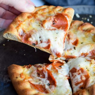 How To Make Trader Joe's Pizza Dough Into Freezer Friendly Premade Pizza Crusts - Four mini pizza crusts in the freezer for emergencies!! Using SUPER cheap Trader Joe's dough! - ProjectMealPlan.com
