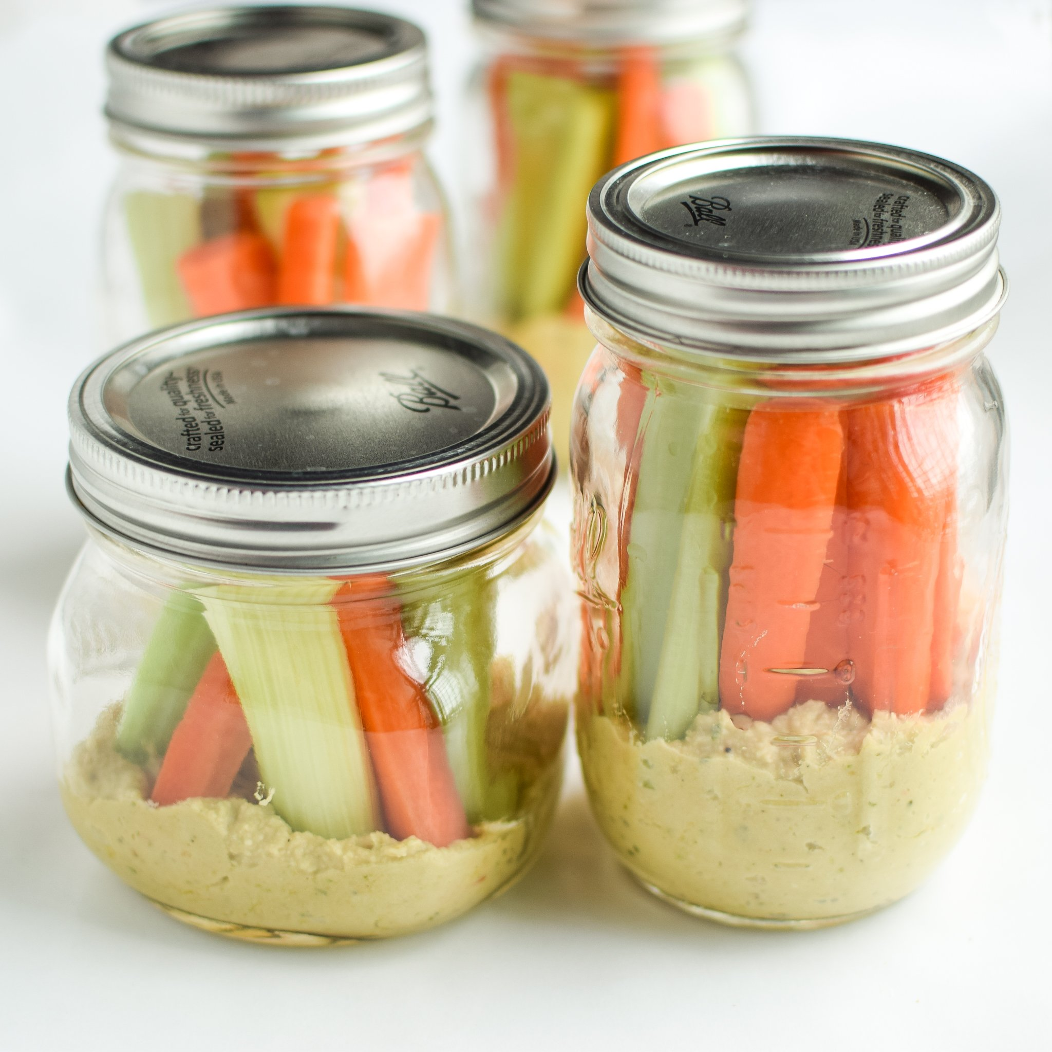 Snack Prep: Veggie Sticks with Easy Pesto Hummus recipe - A pesto twist on the classic hummus, plus, have you tried it with veggies in a mason jar? - ProjectMealPlan.com