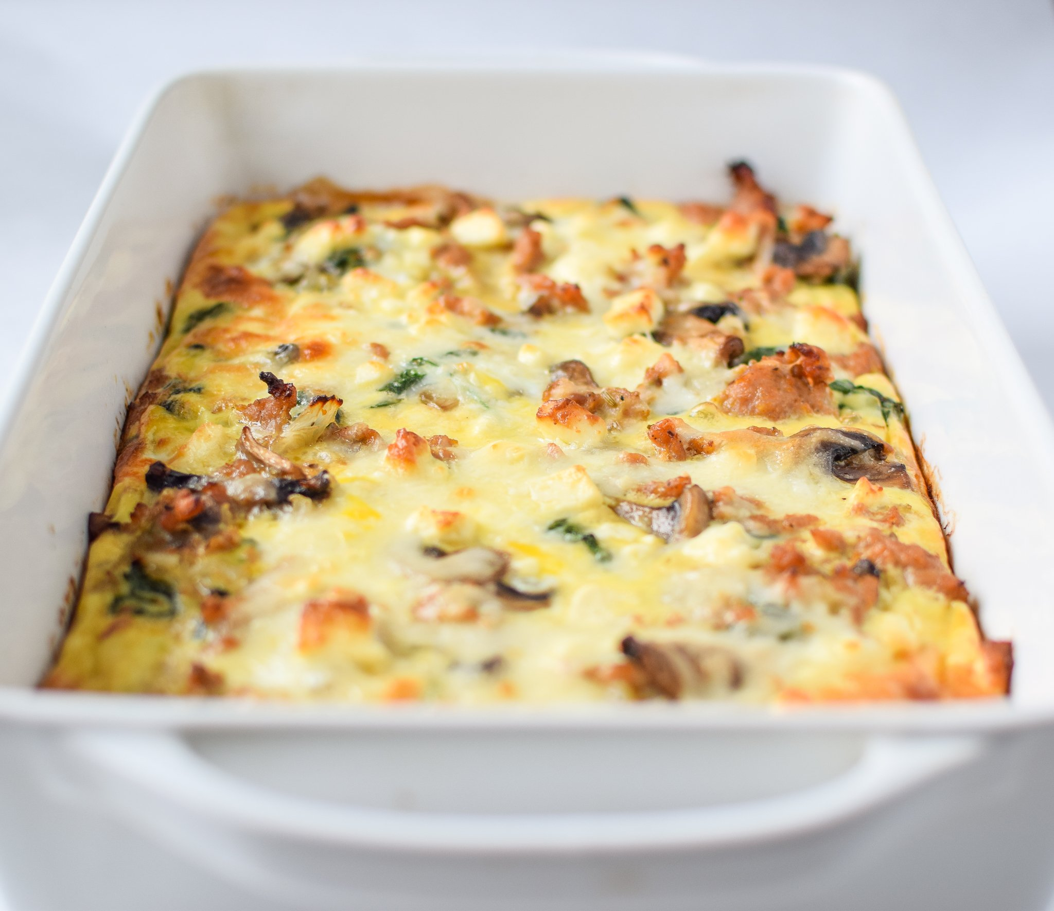 Spinach Feta Chicken Sausage Breakfast Casserole with Sweet Potato Crust - A tasty breakfast favorite for a crowd (or meal prepped!) with an easy sweet potato crust! - ProjectMealPlan.com
