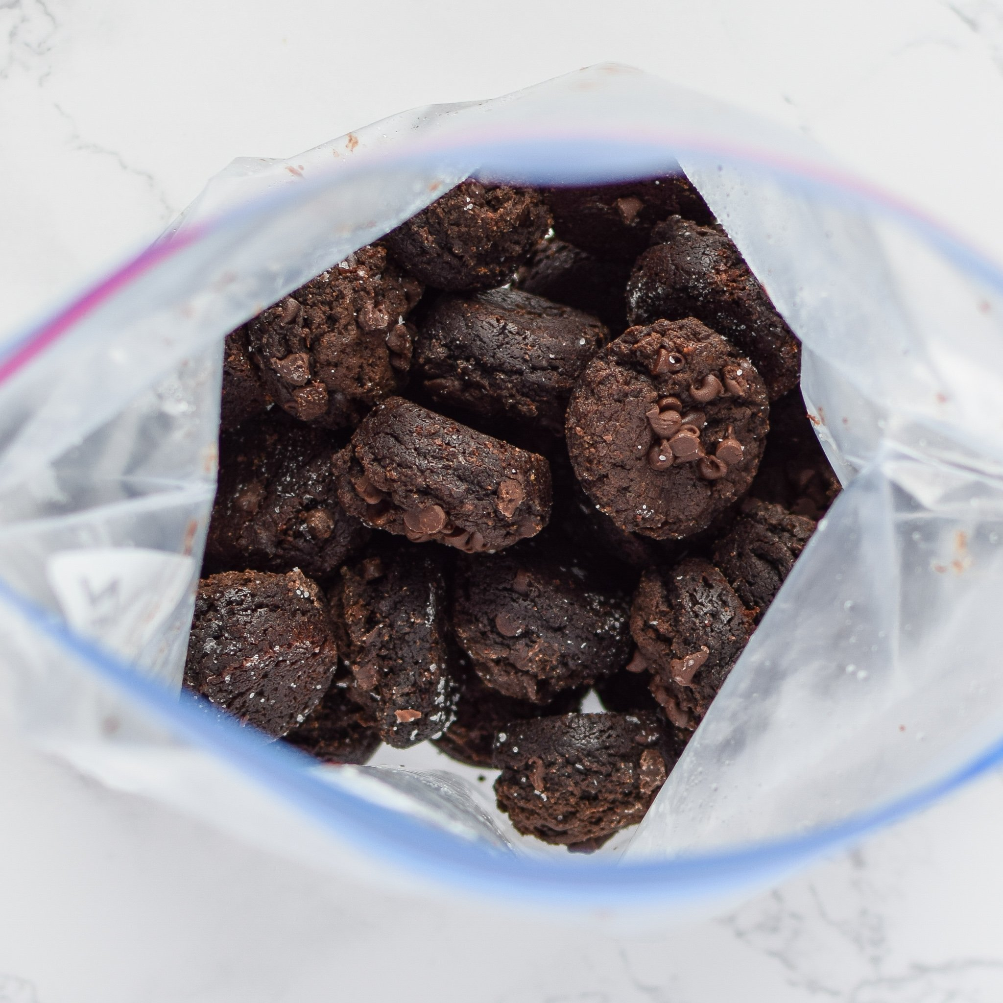 A Ziploc bag full of freezer friendly sweet potato brownie bites.
