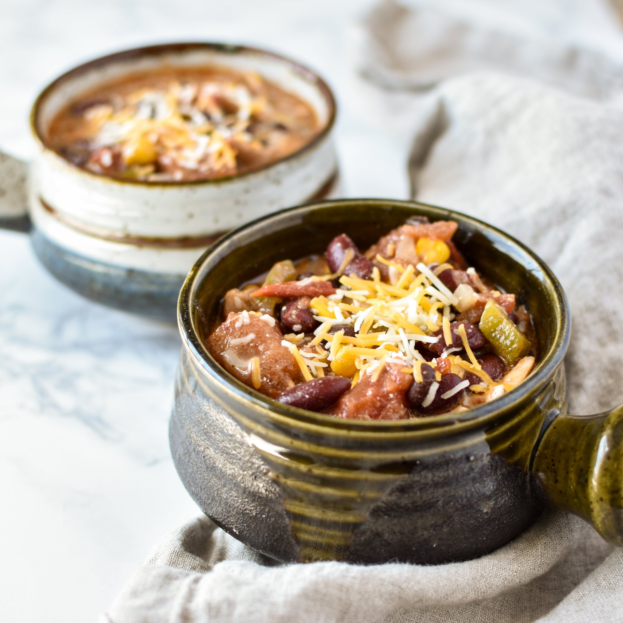 Easy Crockpot Chicken Thigh Taco Chili - Super easy crock pot taco chili to help clear out your pantry! Set it and forget it :) - ProjectMealPlan.com
