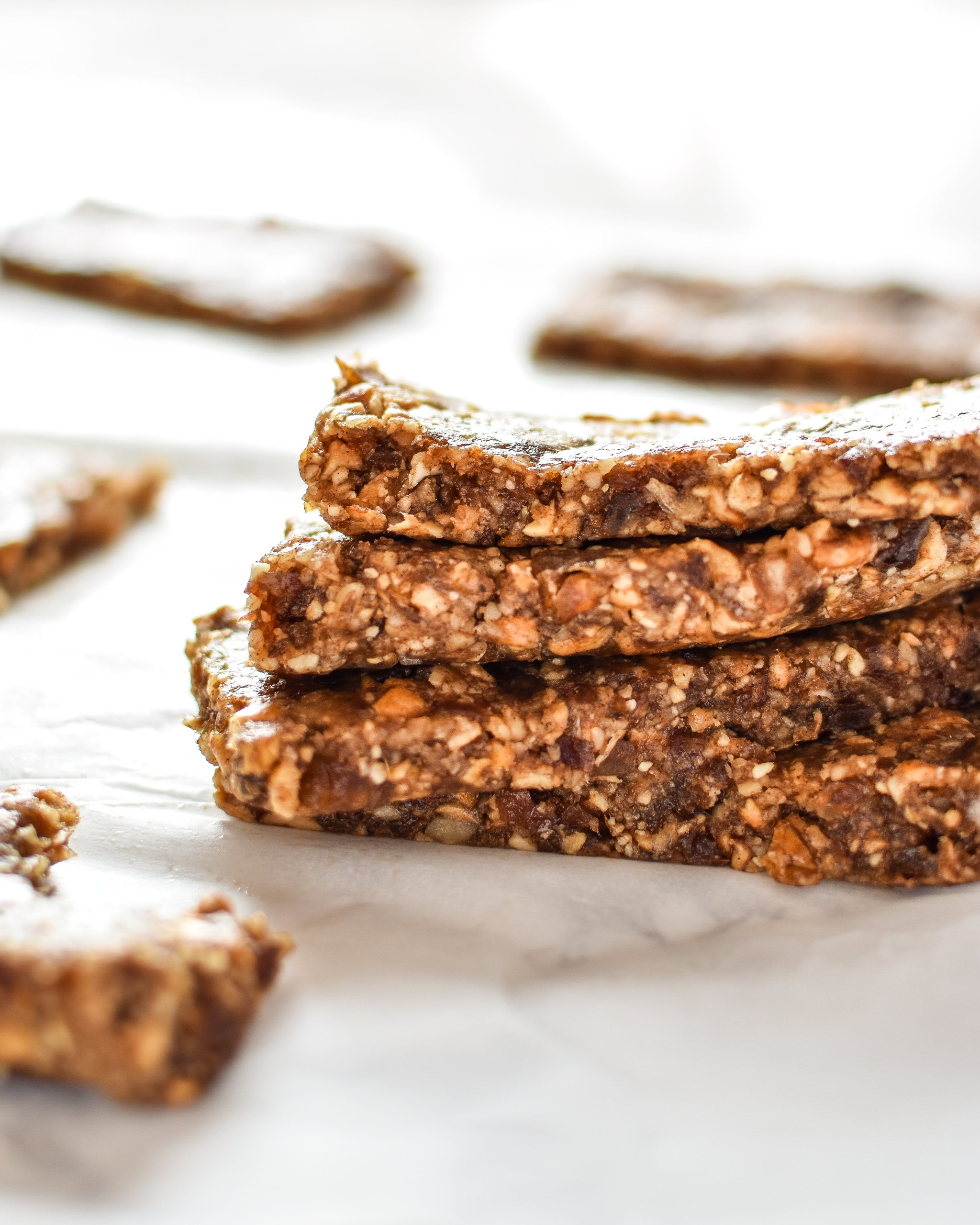 No-Bake Cinnamon Apple Date Bars stacked on one another, made with dates and dried apples