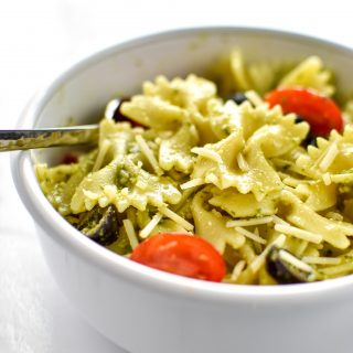 A delicious bowl of Incredibly Easy Pesto Pasta Salad - just 6 simple ingredients for the best make-ahead side dish! - ProjectMealPlan.com