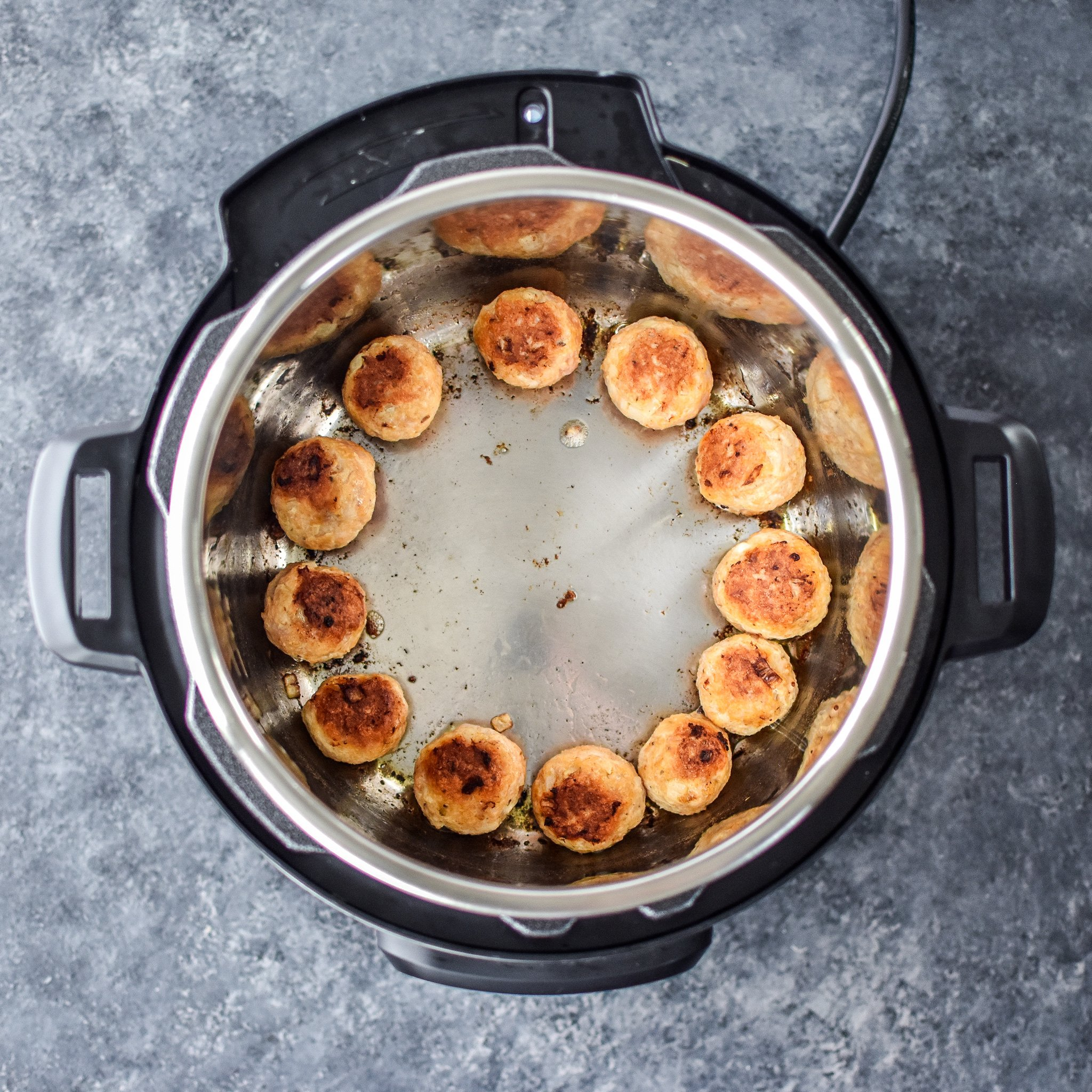 Chicken meatballs browning in an Instant Pot.