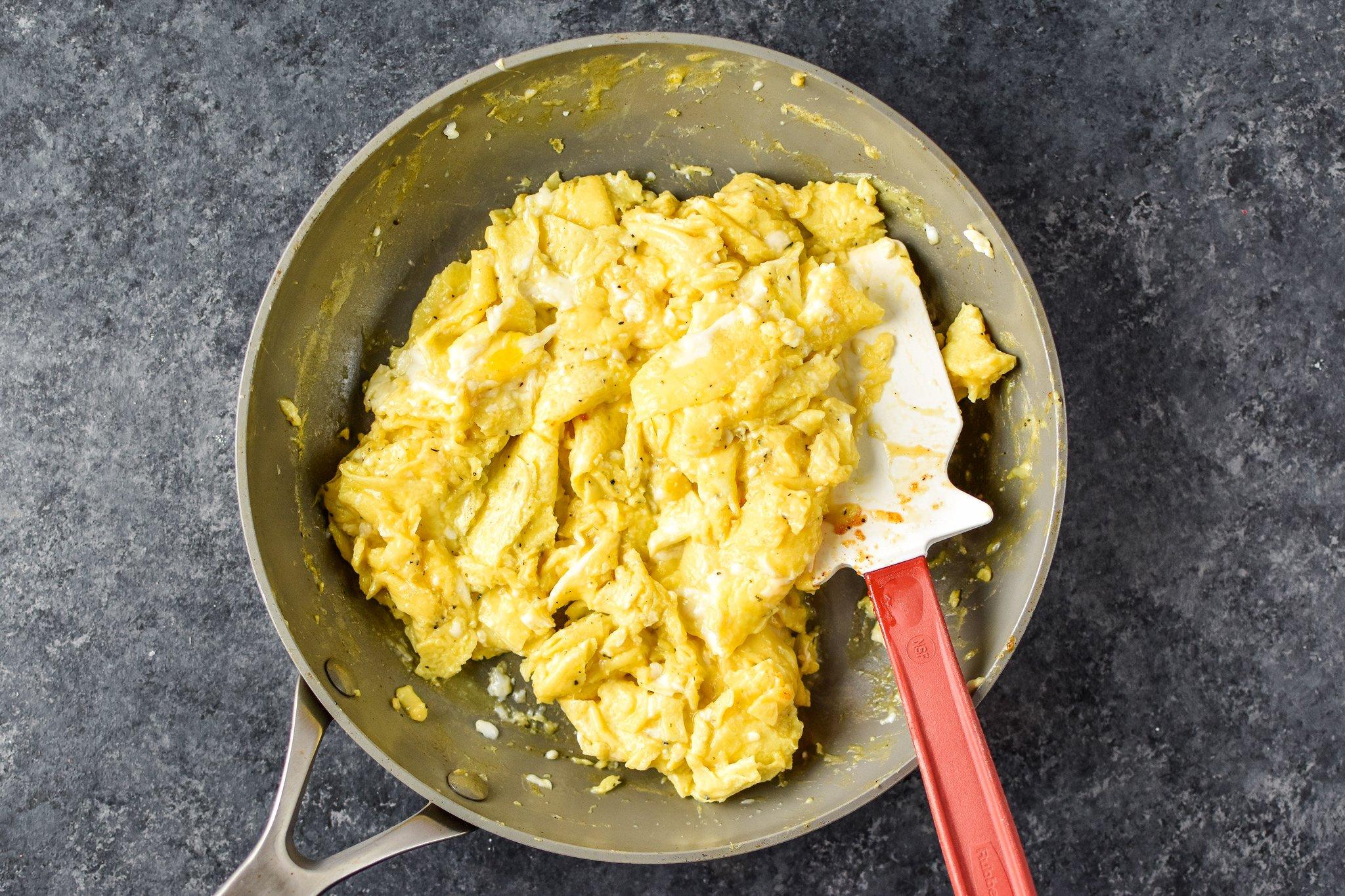 A pan of fresh scrambled eggs, top view.