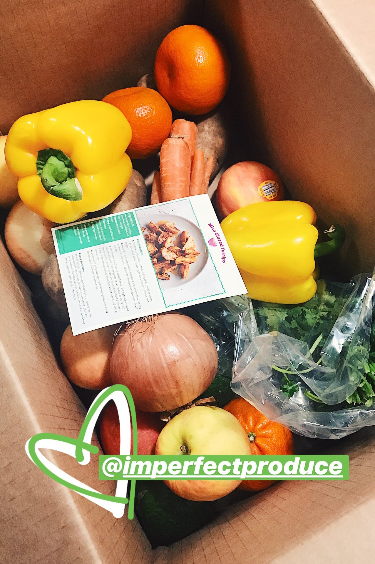 A box of produce from Imperfect Produce. It's important to plan around what food you already have before purchasing new.