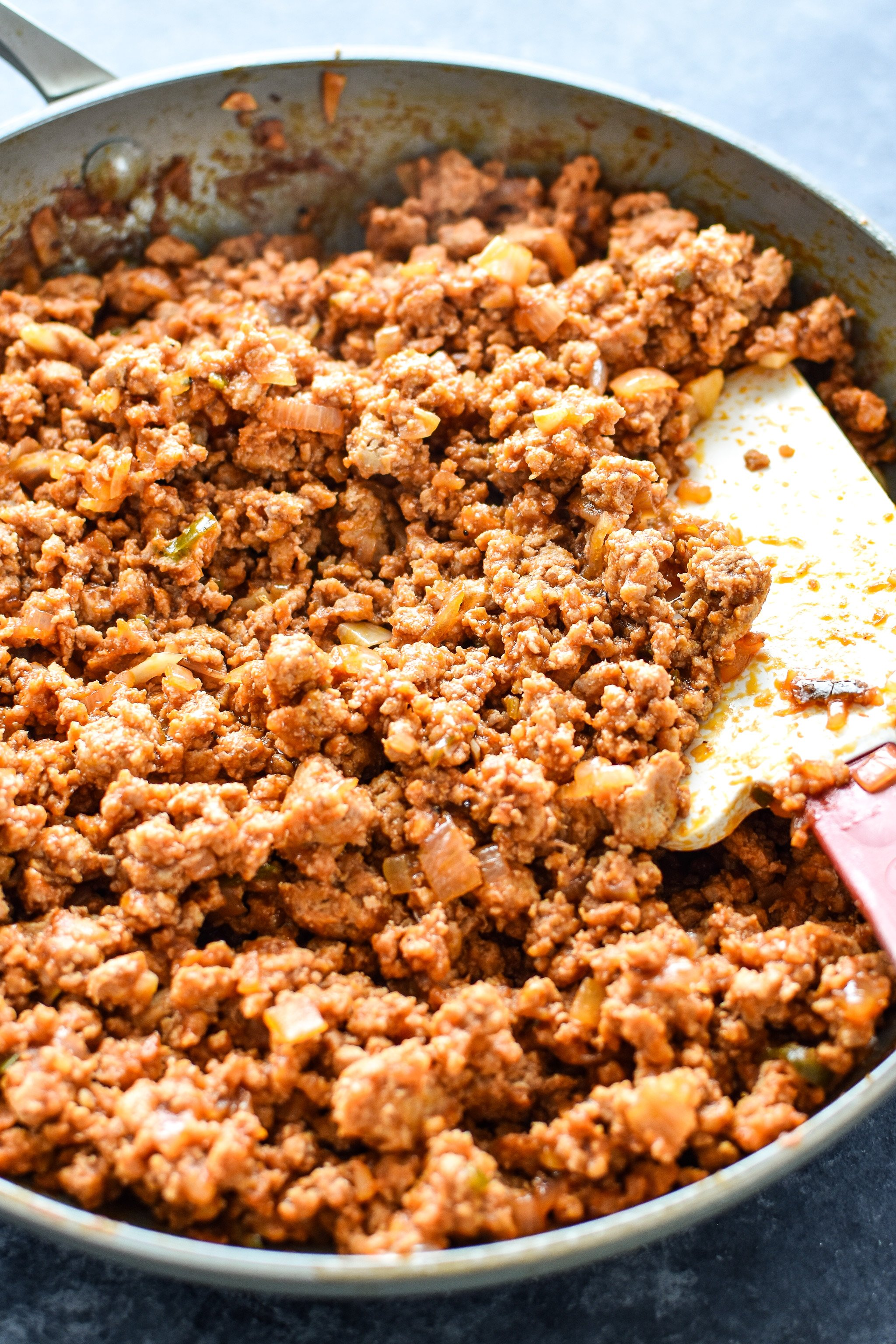 A big skillet full of homemade ground turkey sloppy joes done cooking.