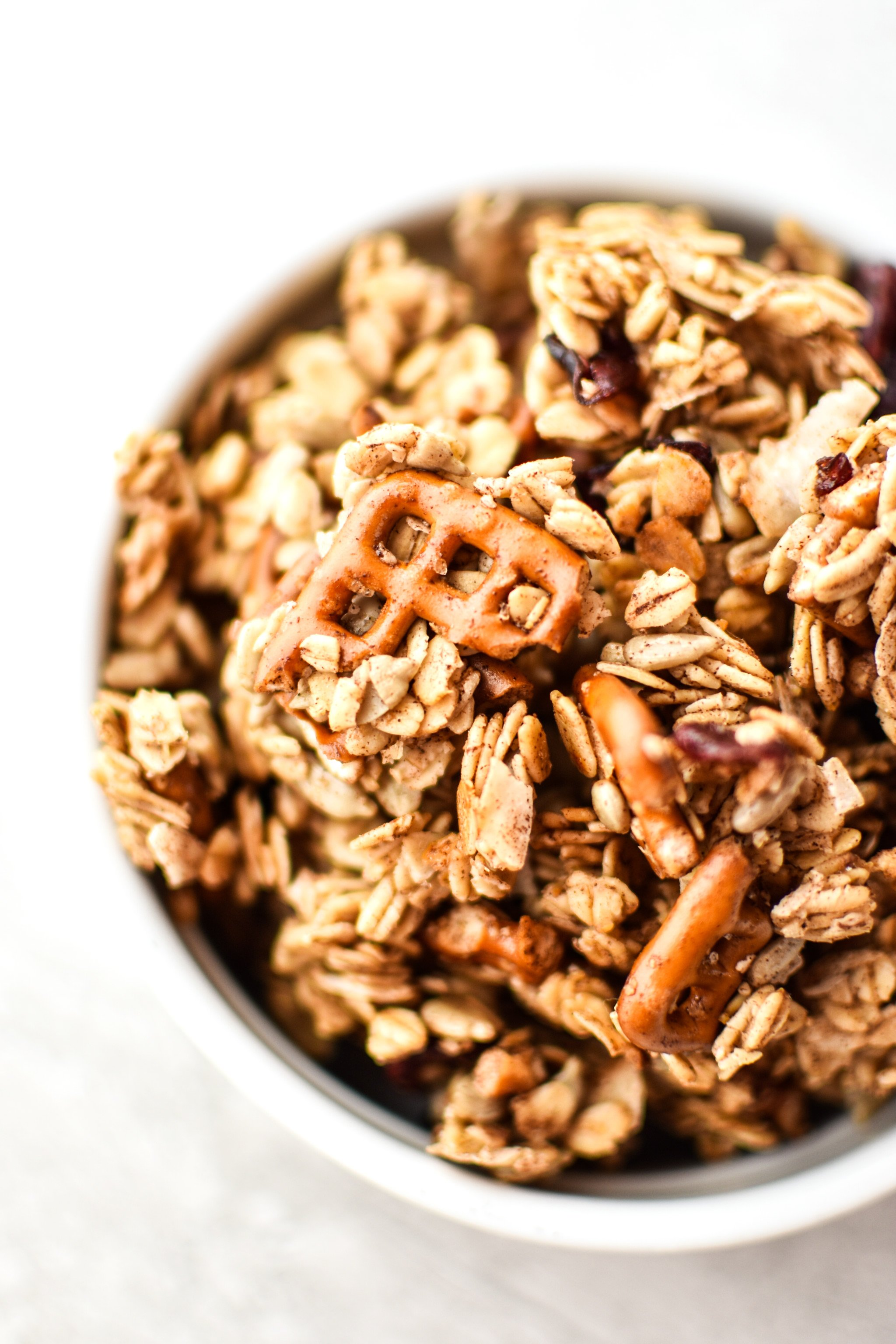 A bowl of super clumpy nut free snack mix granola.