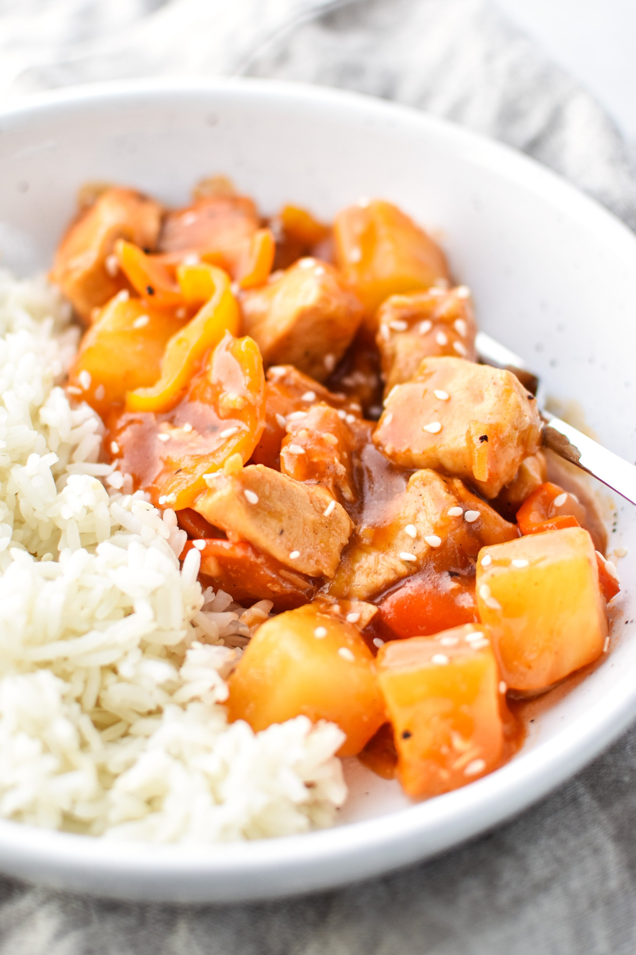 Bowl of Sweet Ginger BBQ Chicken Meal Prep from the side with rice.