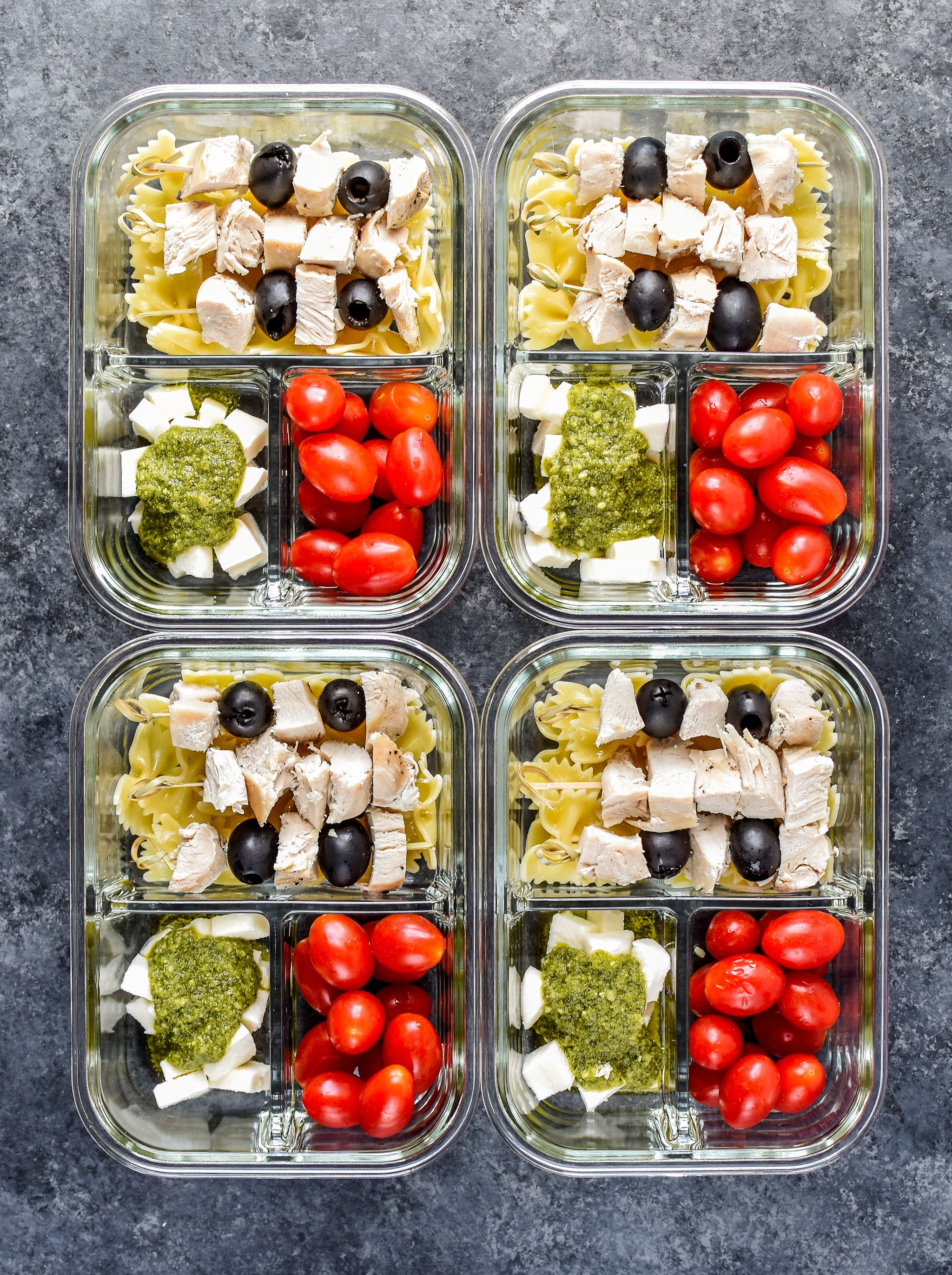 DIY Chicken Pesto Pasta Skewers Meal Prep with fresh mozz, grape tomatoes, bowtie pasta and chicken breast.