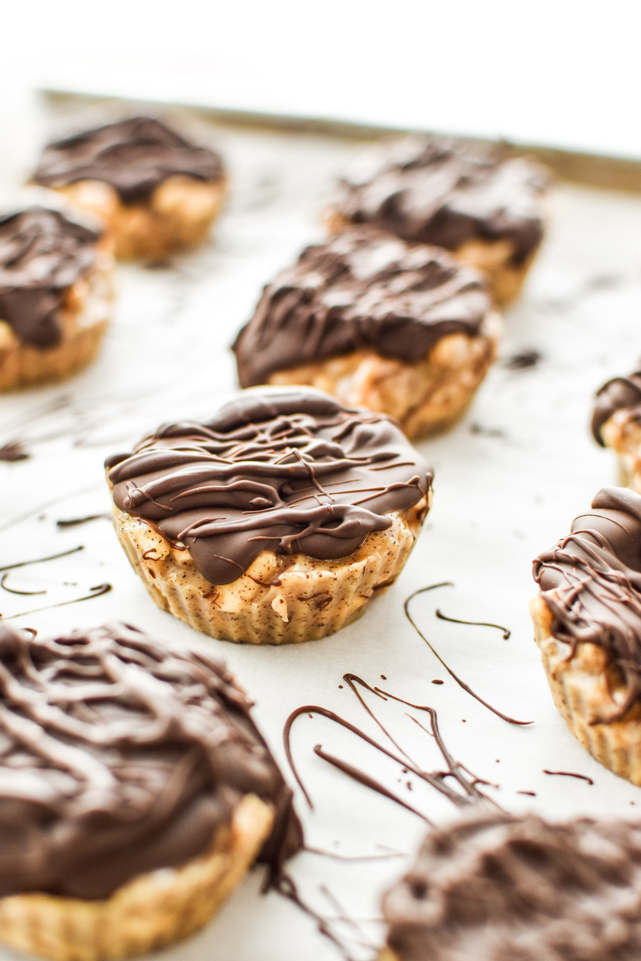 Espresso Crunch Cashew Butter Cups with chocolate drizzled on top.