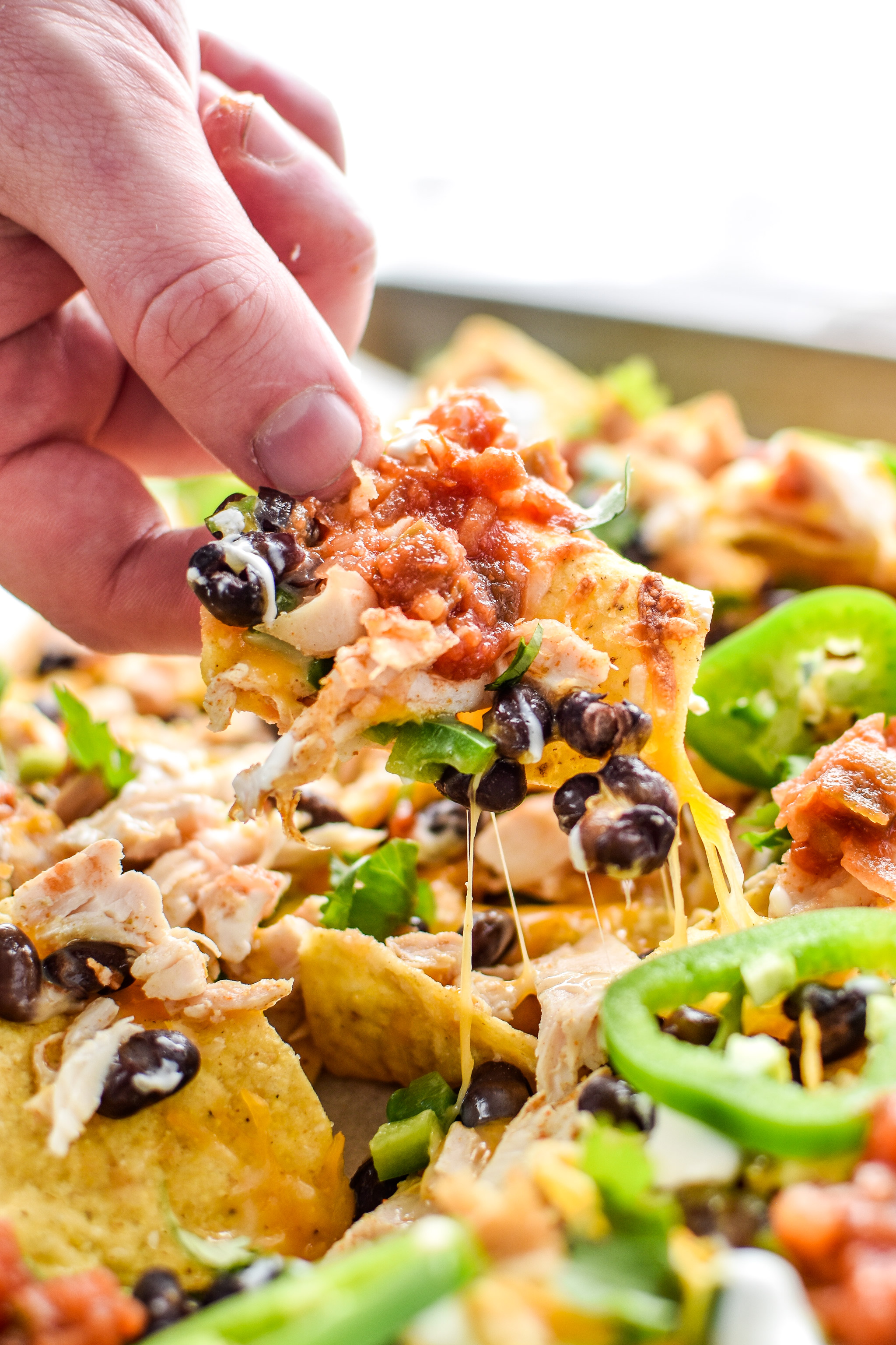Taking a chip from the prep ahead rotisserie chicken nachos sheet pan. Yummy!