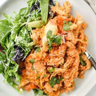 Buffalo Chicken Quinoa Bake served with salad