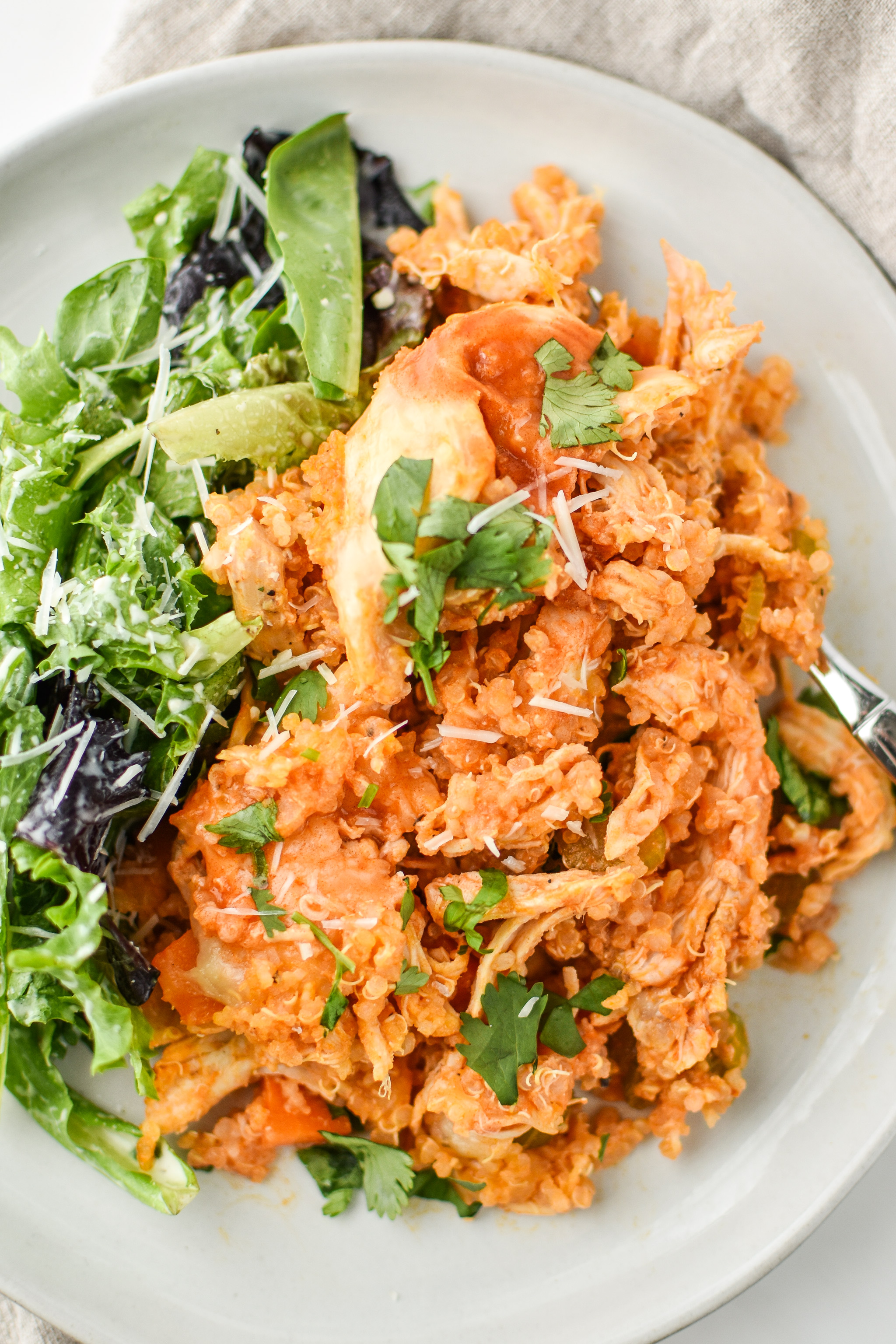Buffalo Chicken Quinoa Bake served with salad.