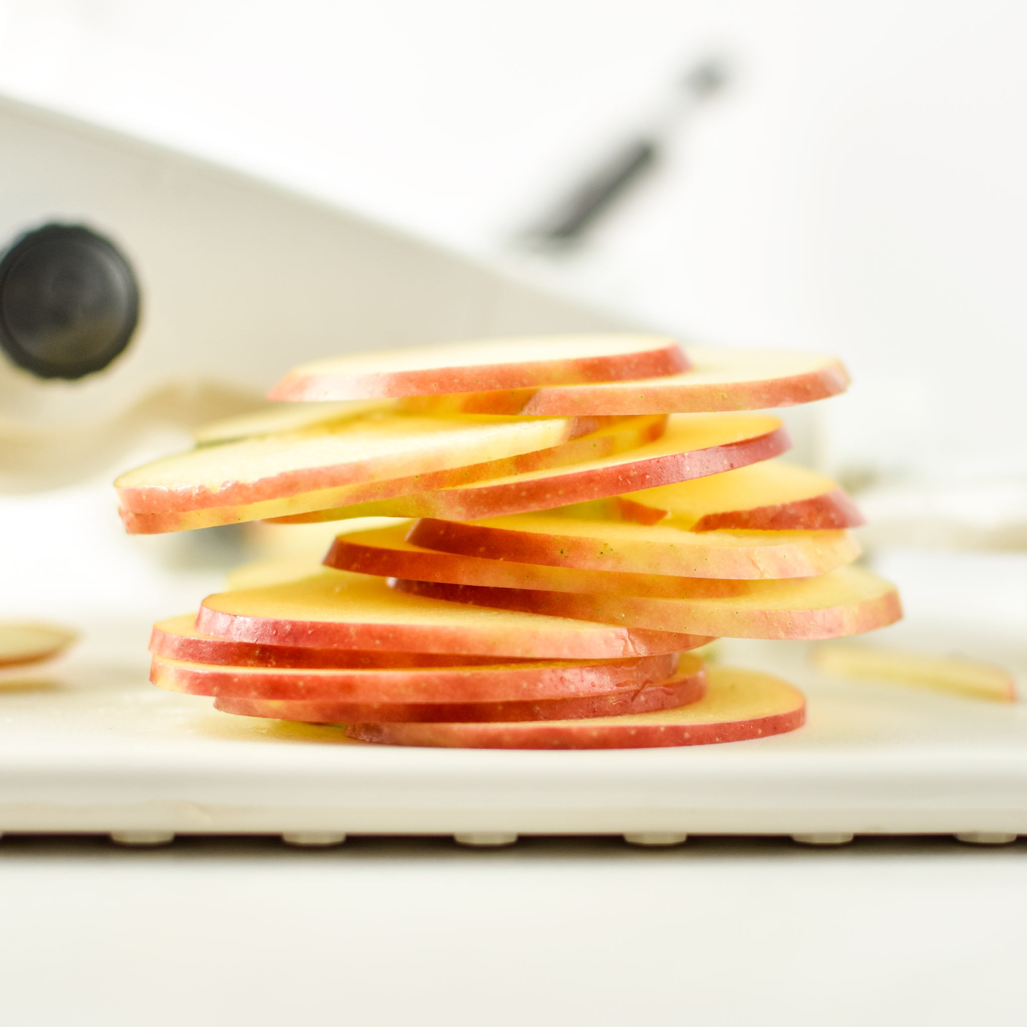 Apples sliced with the mandoline for how to make apples in an air fryer