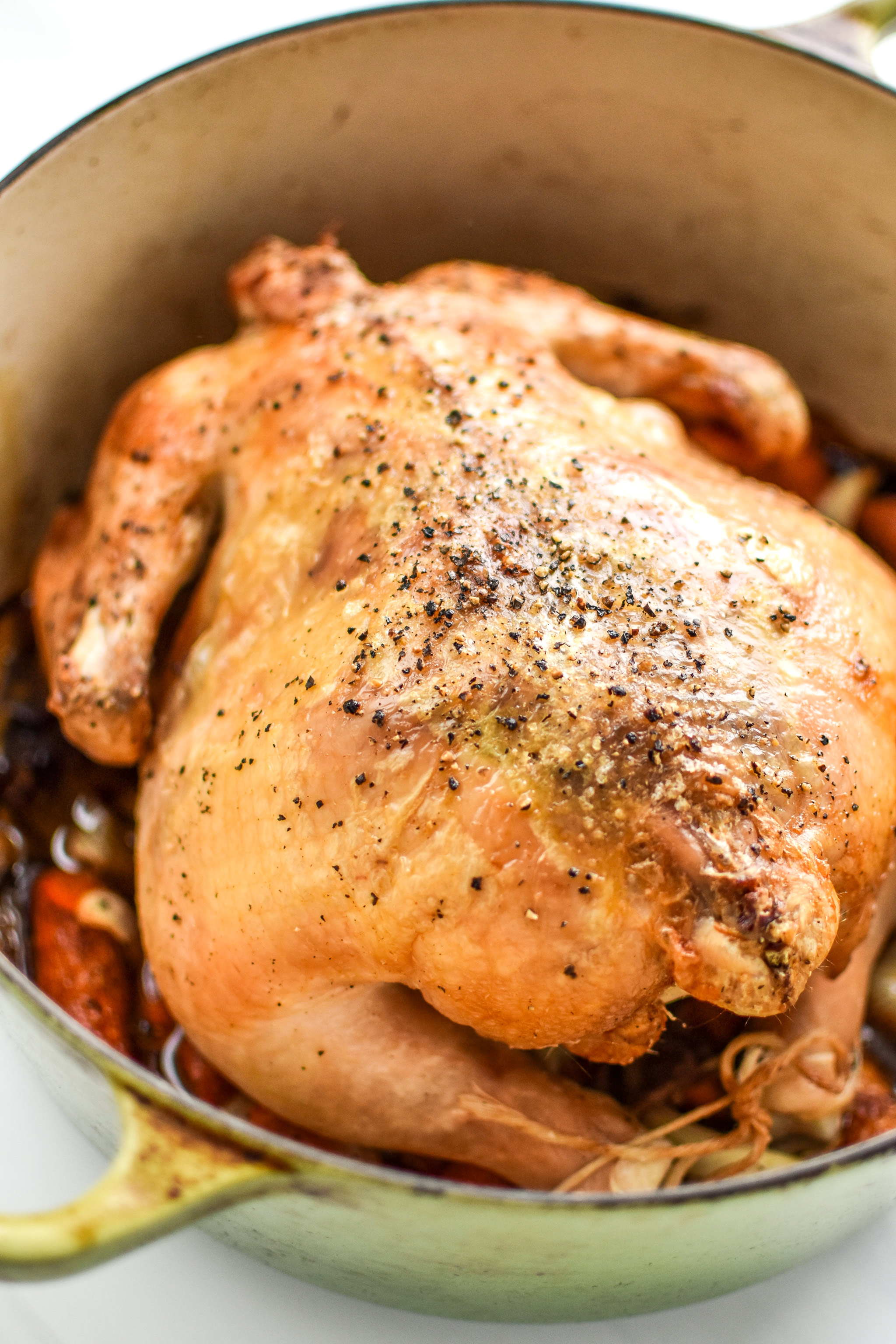 A simple whole roast chicken cooked in a Dutch oven.