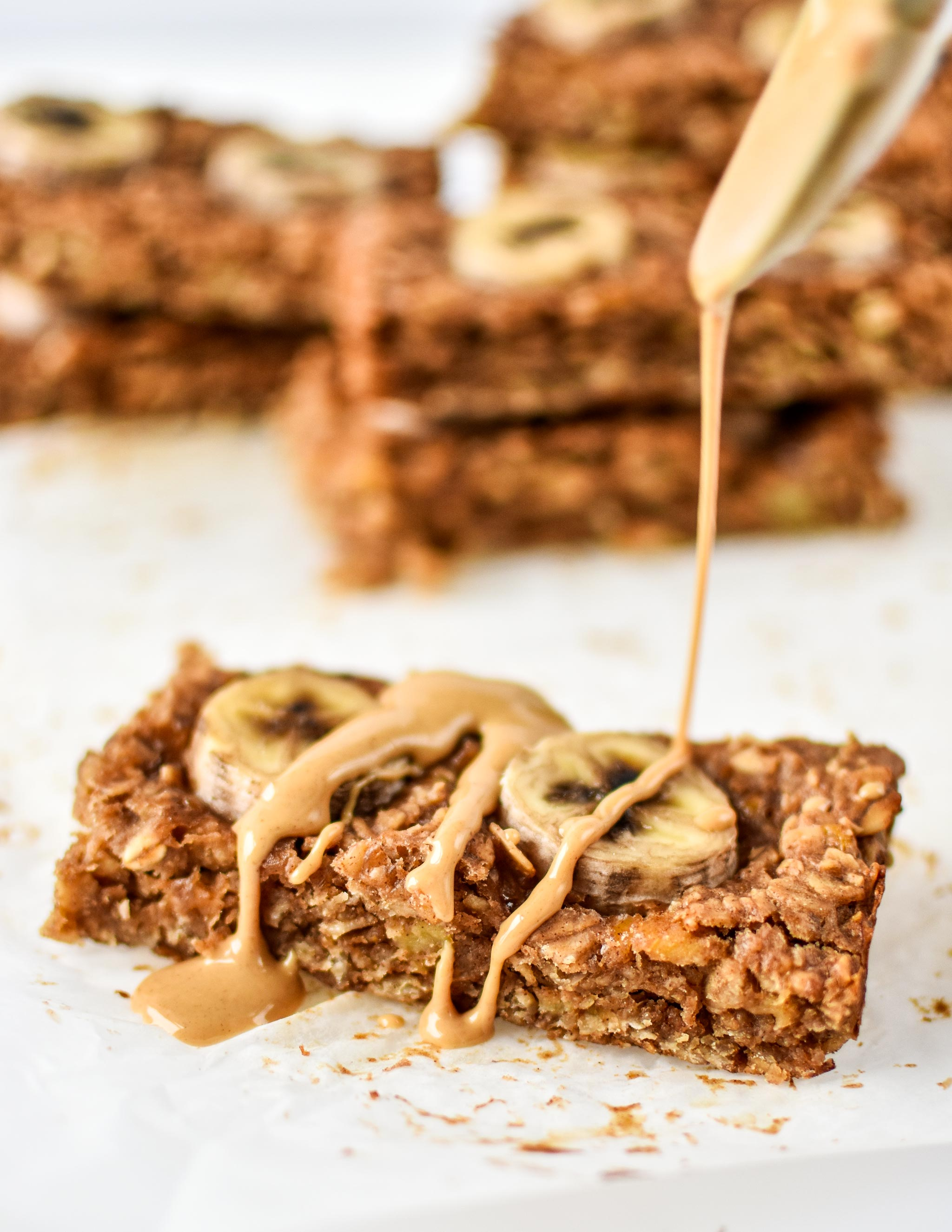 PB Banana Oatmeal Breakfast Bars drizzled with peanut butter