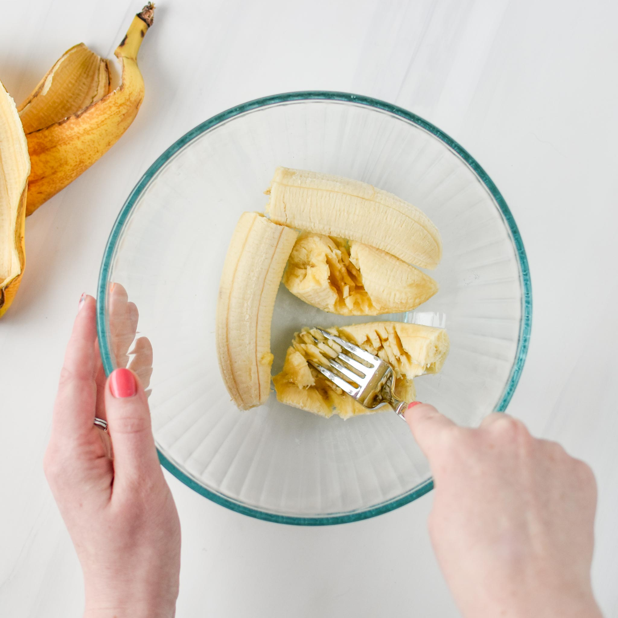 mashing bananas for the peanut butter banana oatmeal breakfast bars