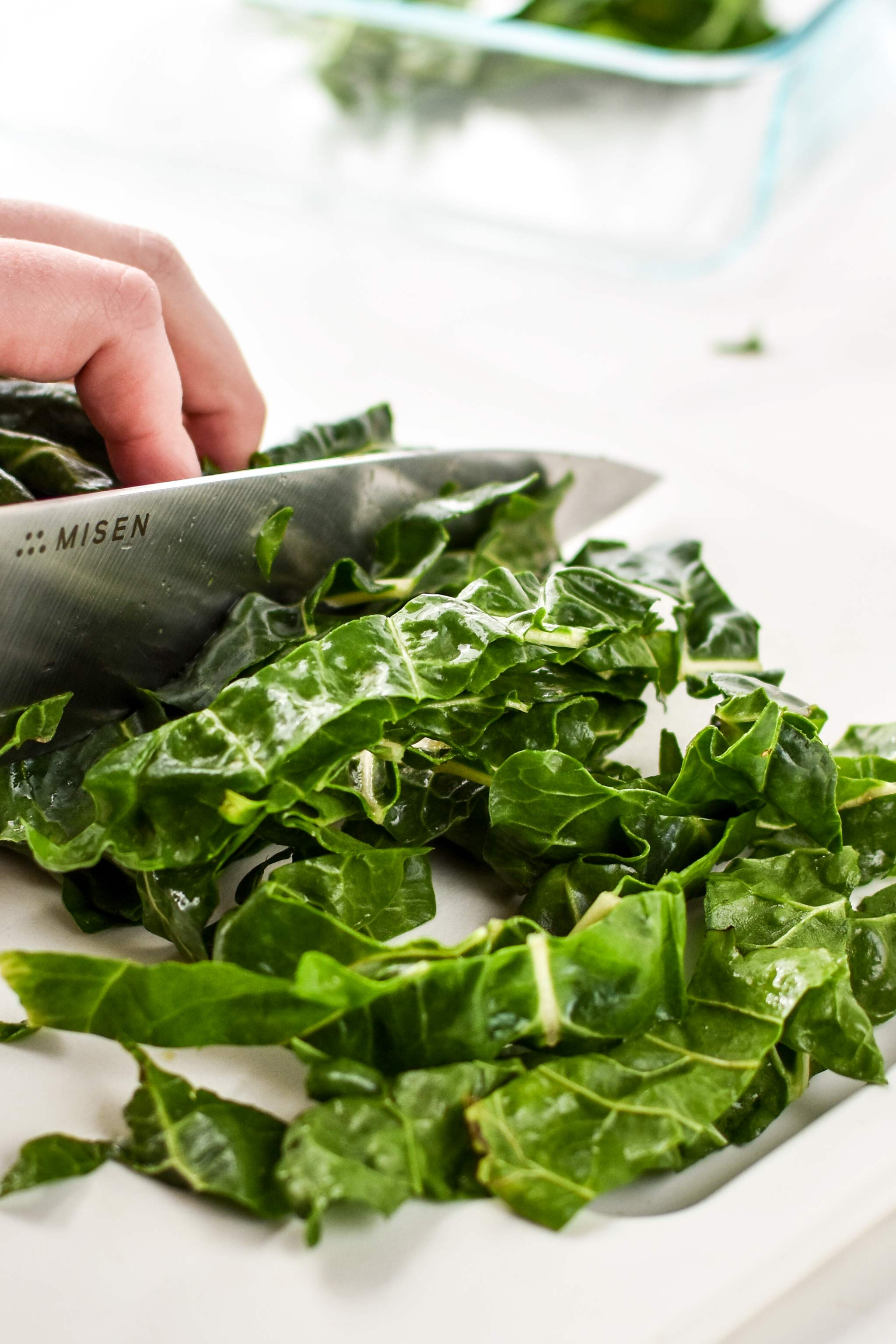 slicing swiss chard for veggie packed breakfast fried rice