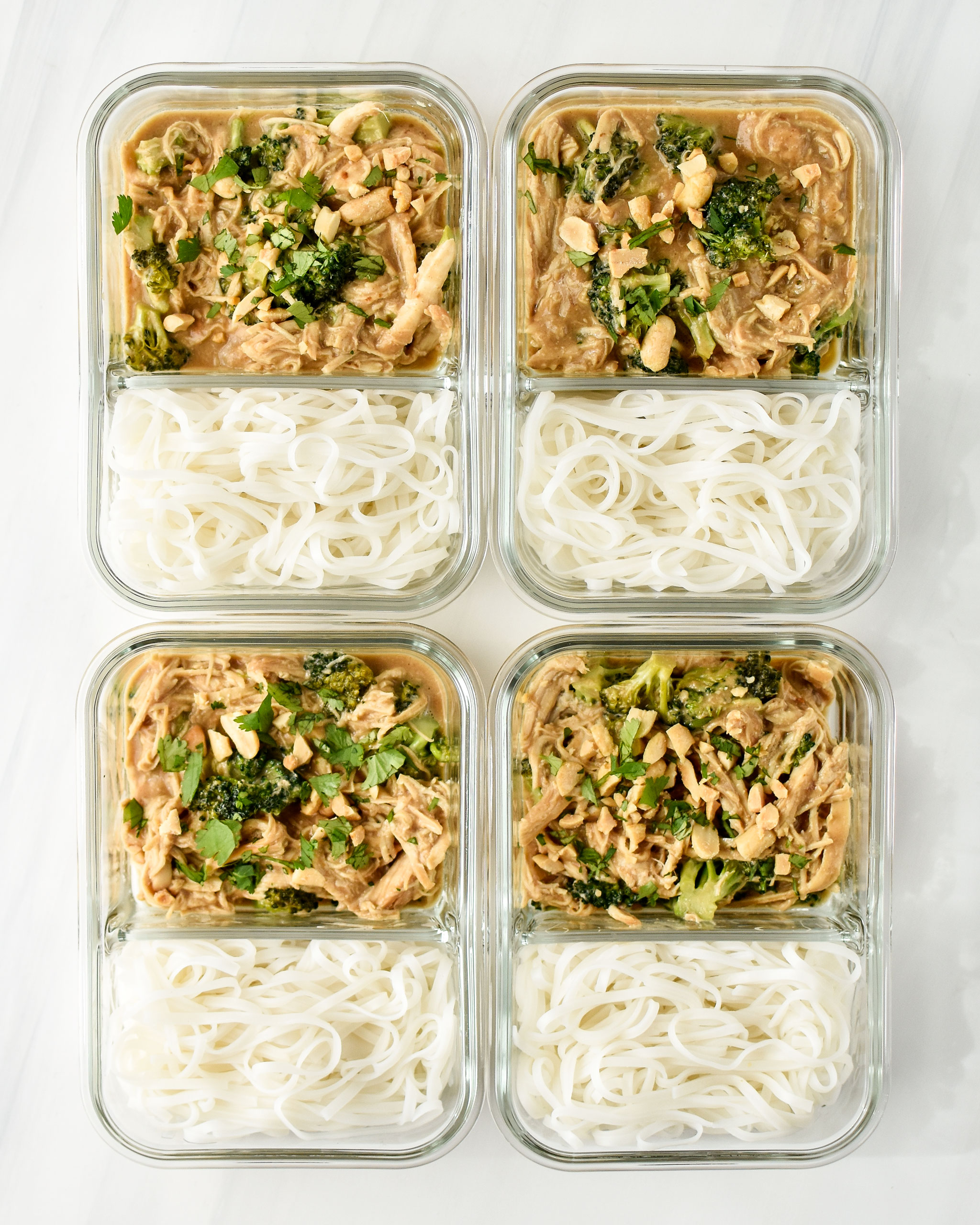 slow cooker peanut chicken noodle meal prep pictured in glass meal prep containers