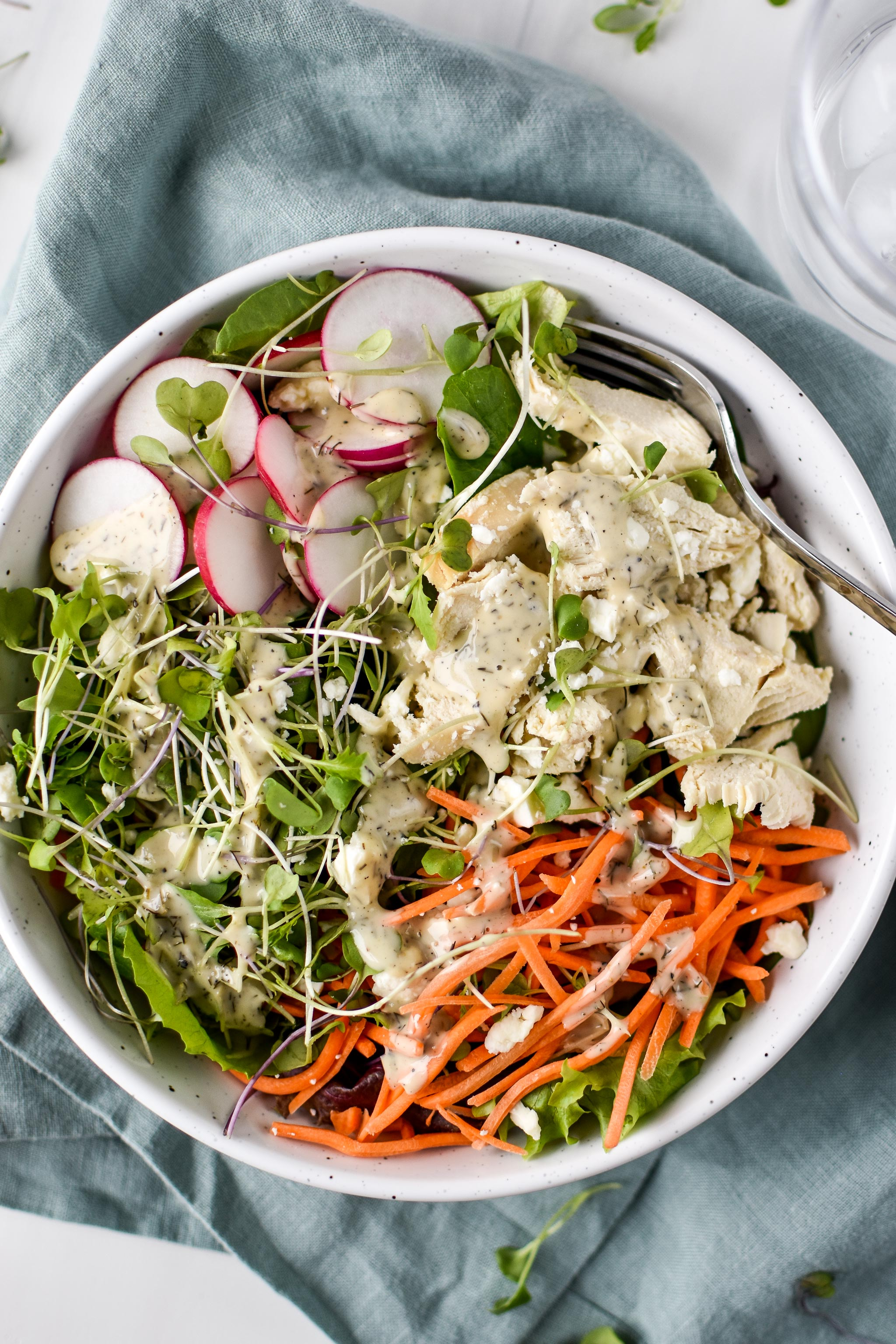 Simple Spring mix lunch salad pictured with ranch dressing on top