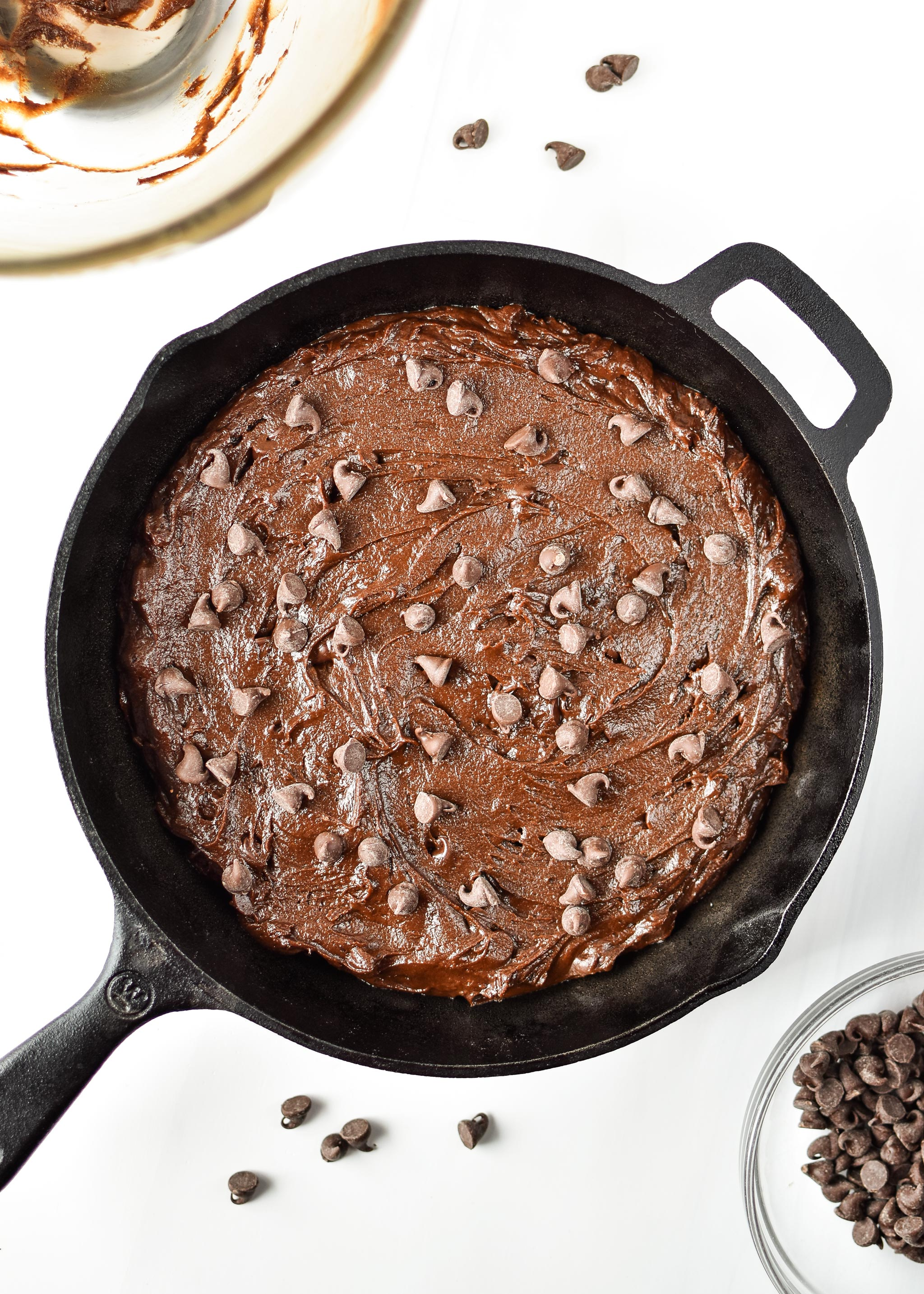 Batter with chocolate chips - sweet potato brownie skillet about to go into the oven