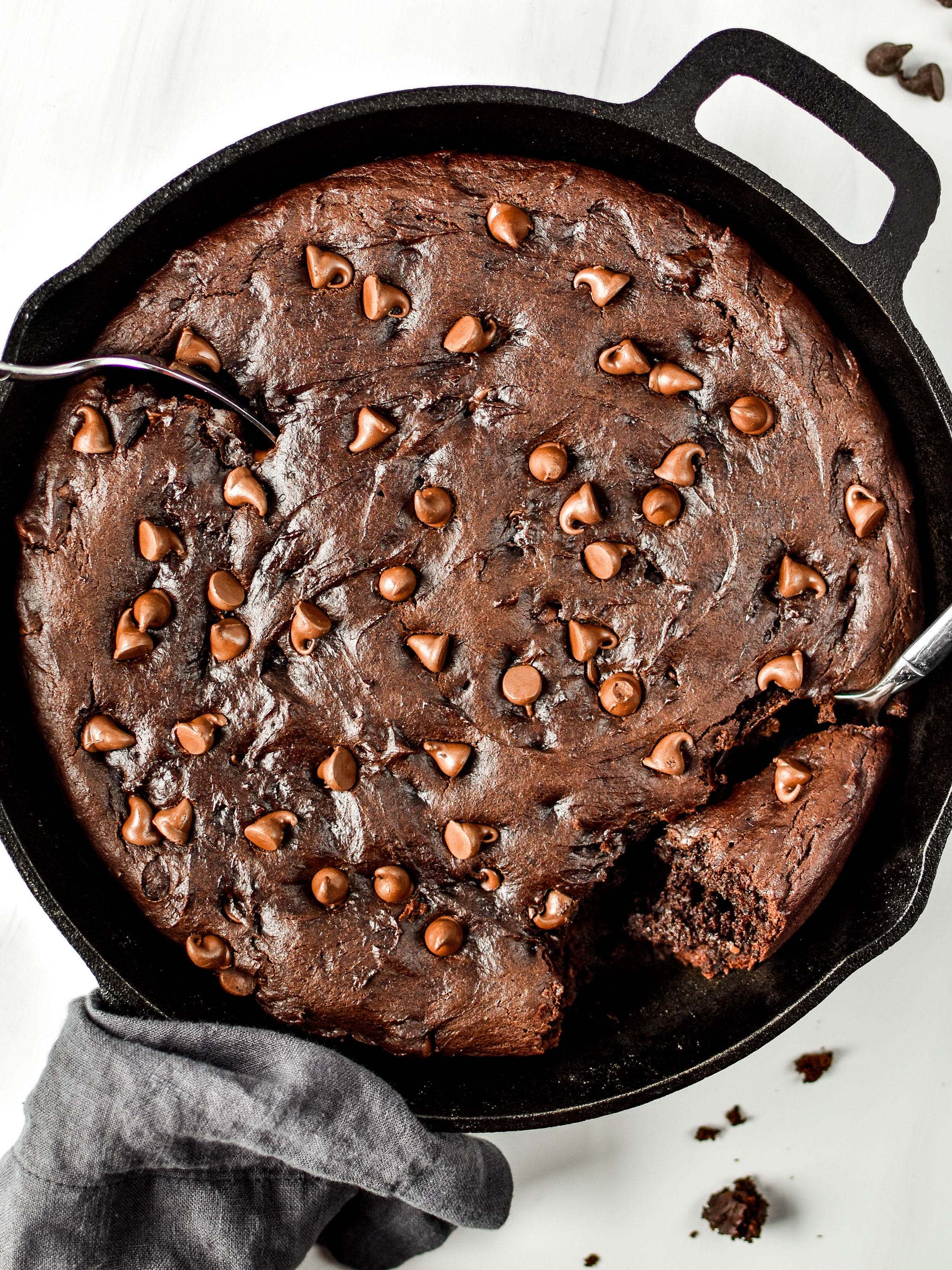 Sweet potato brownie skillet pictured from above with two spoons digging in