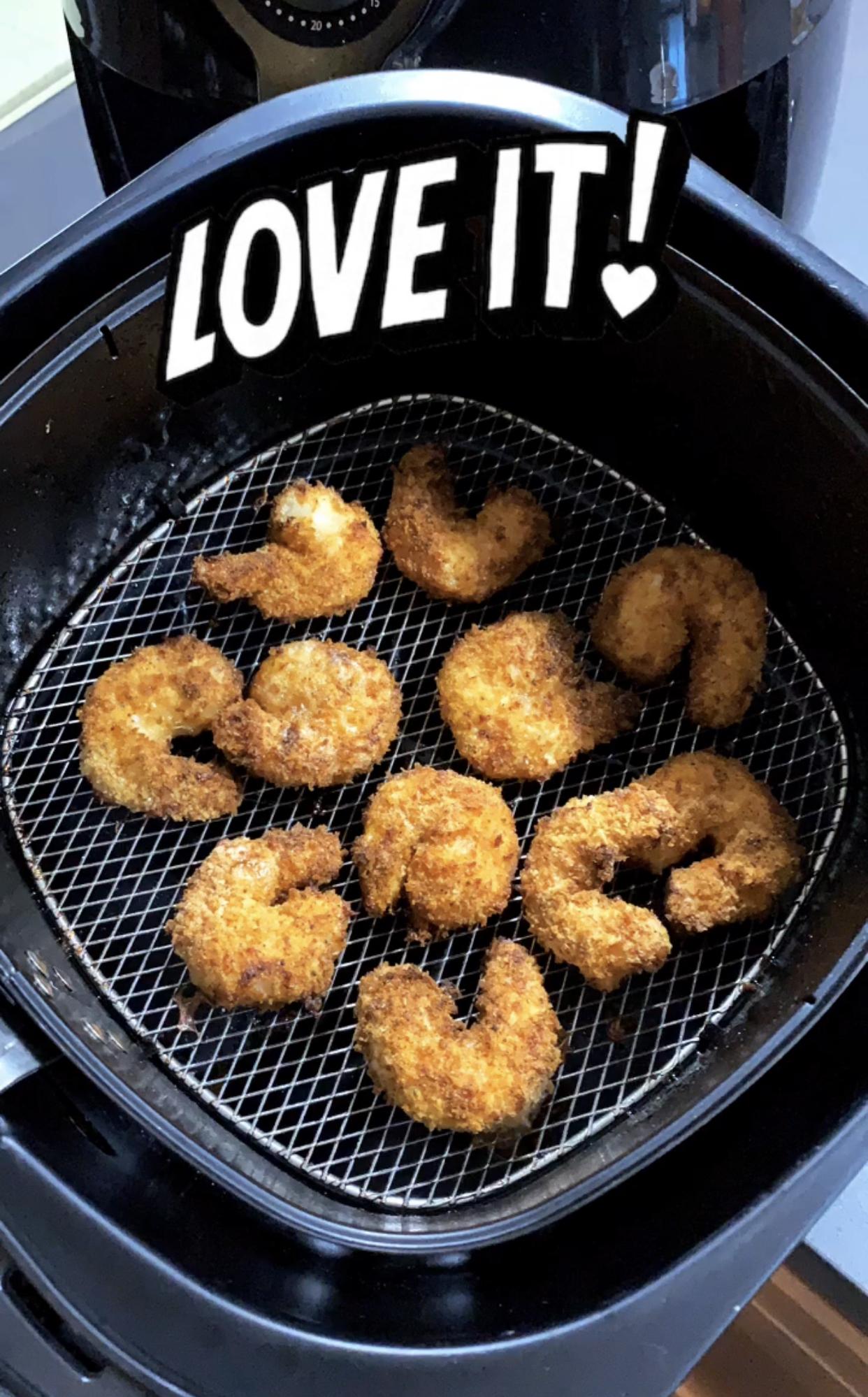crispy shrimp in the air fryer basket