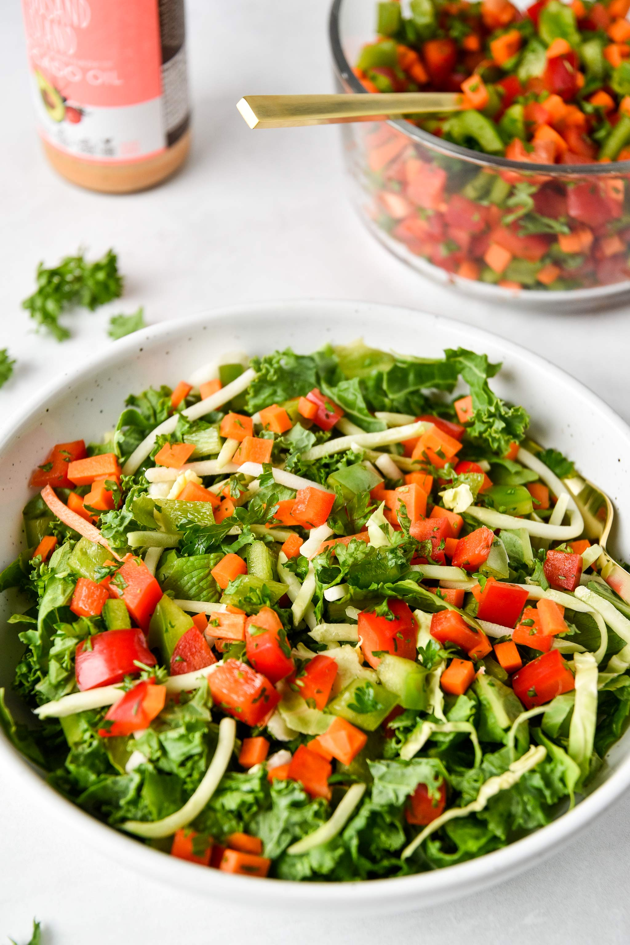 a green salad with vegetable confetti