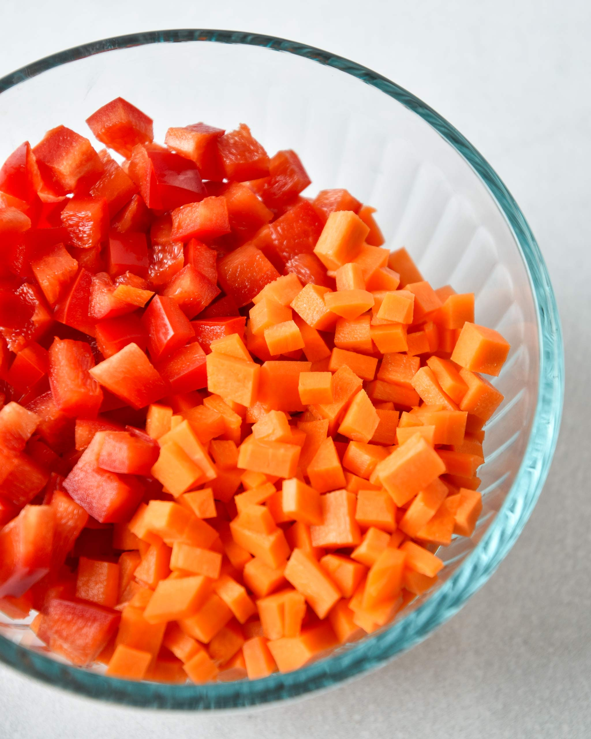 red bell peppers and carrots chopped up for the recipe