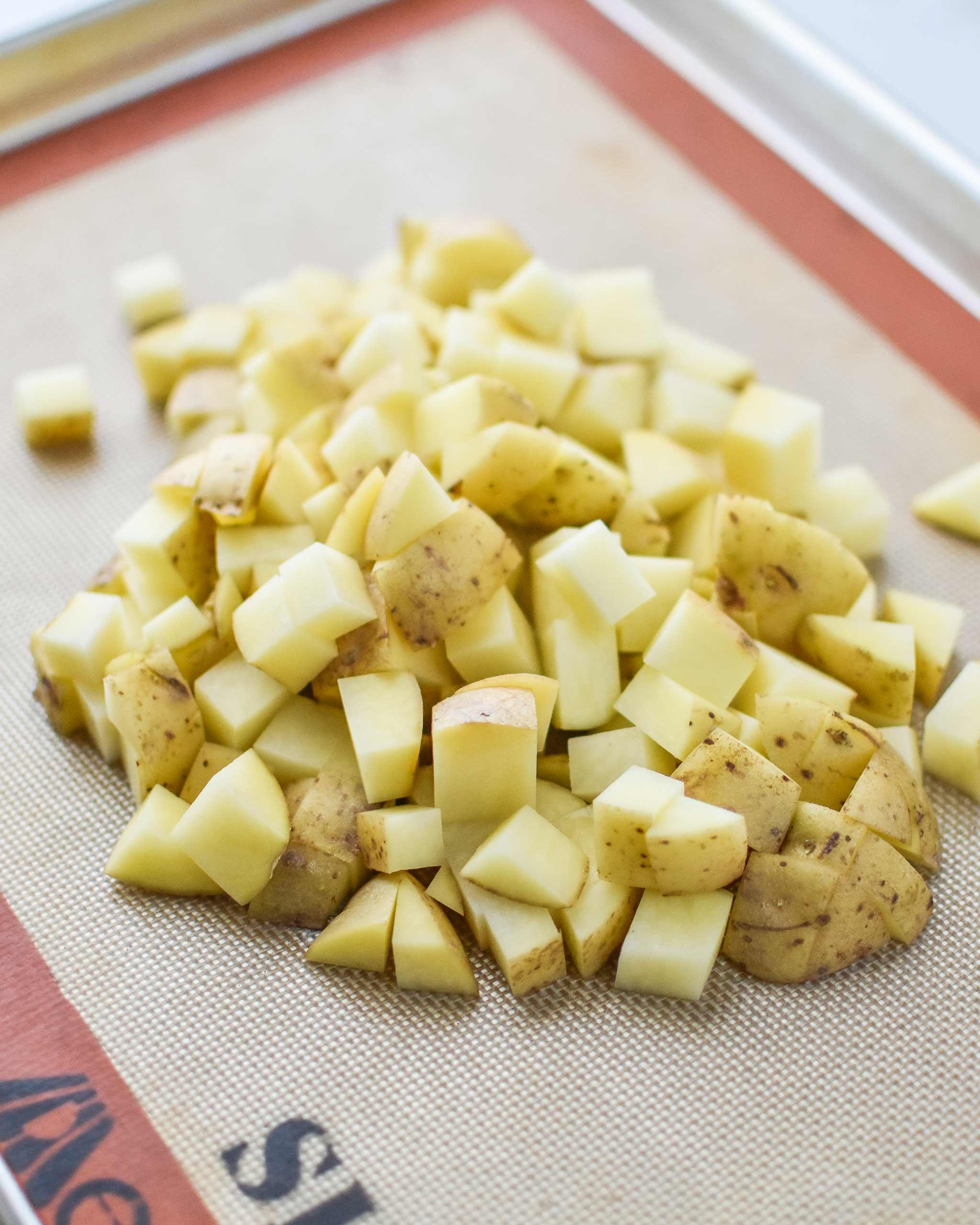 diced yukon gold potatoes on a sheet pan