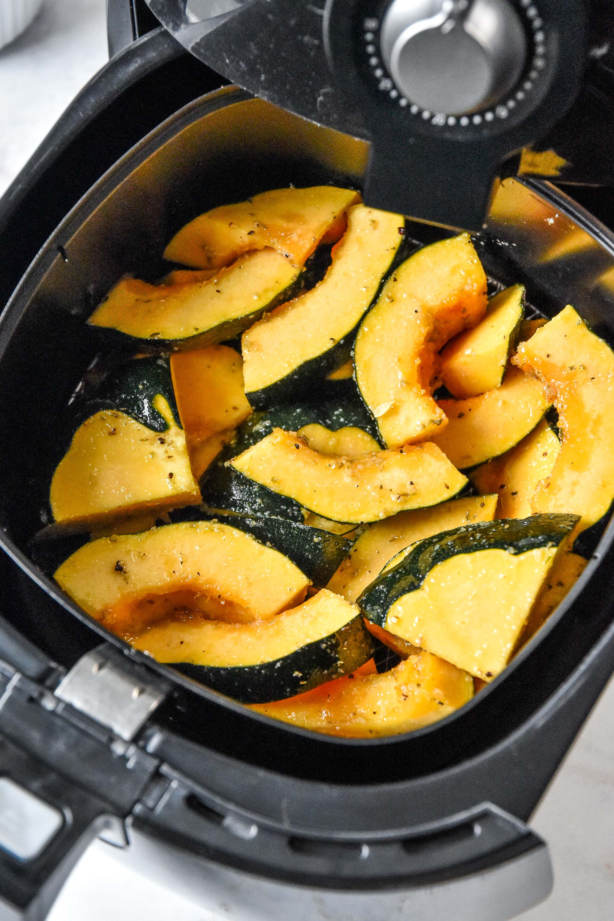 acorn squash in the air fryer ready to be cooked