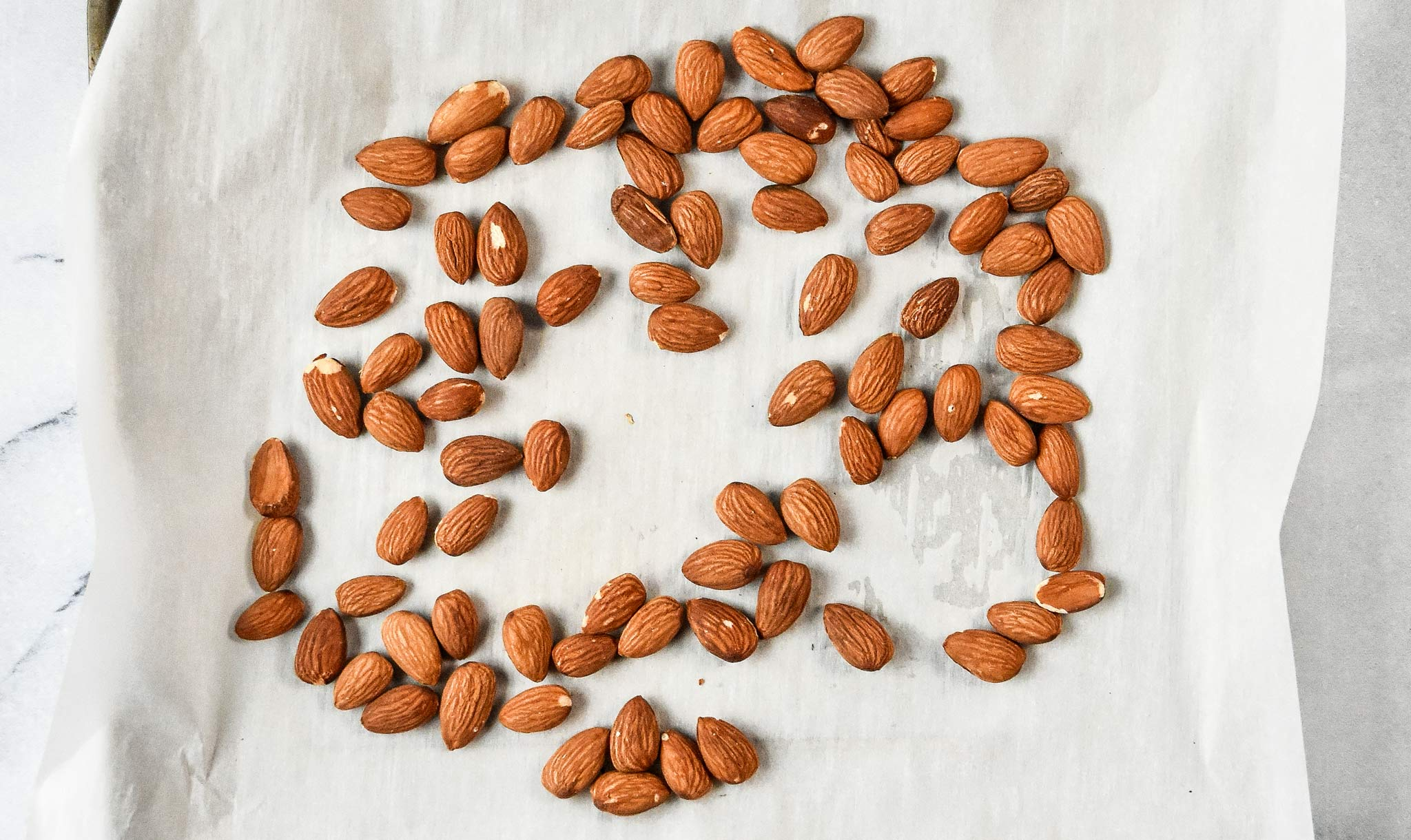 toasted almonds on a sheet tray