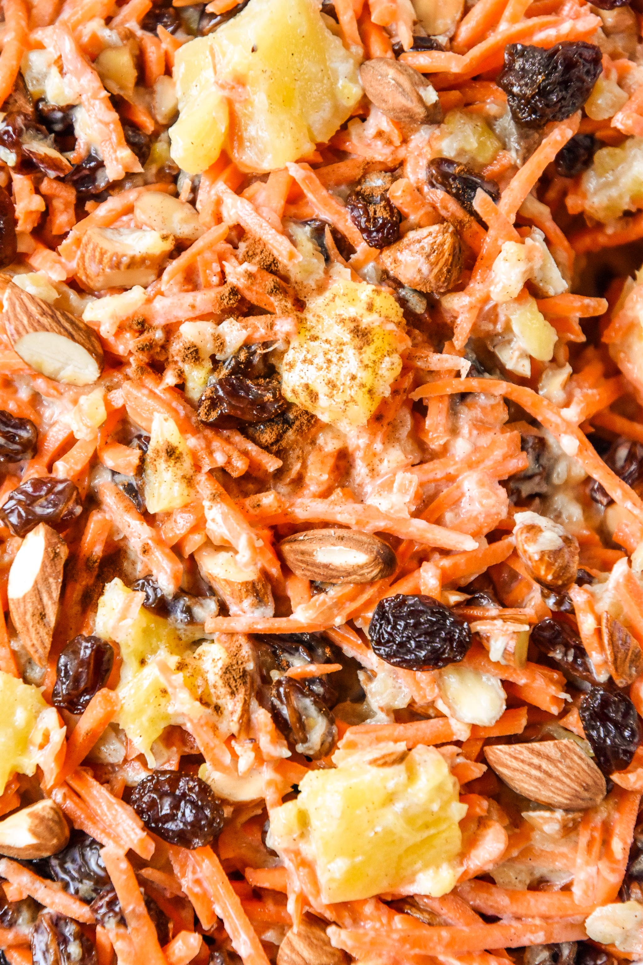 close up of the cinnamon raisin carrot salad in a bowl