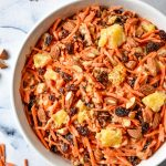 cinnamon raisin carrot salad in a white bowl