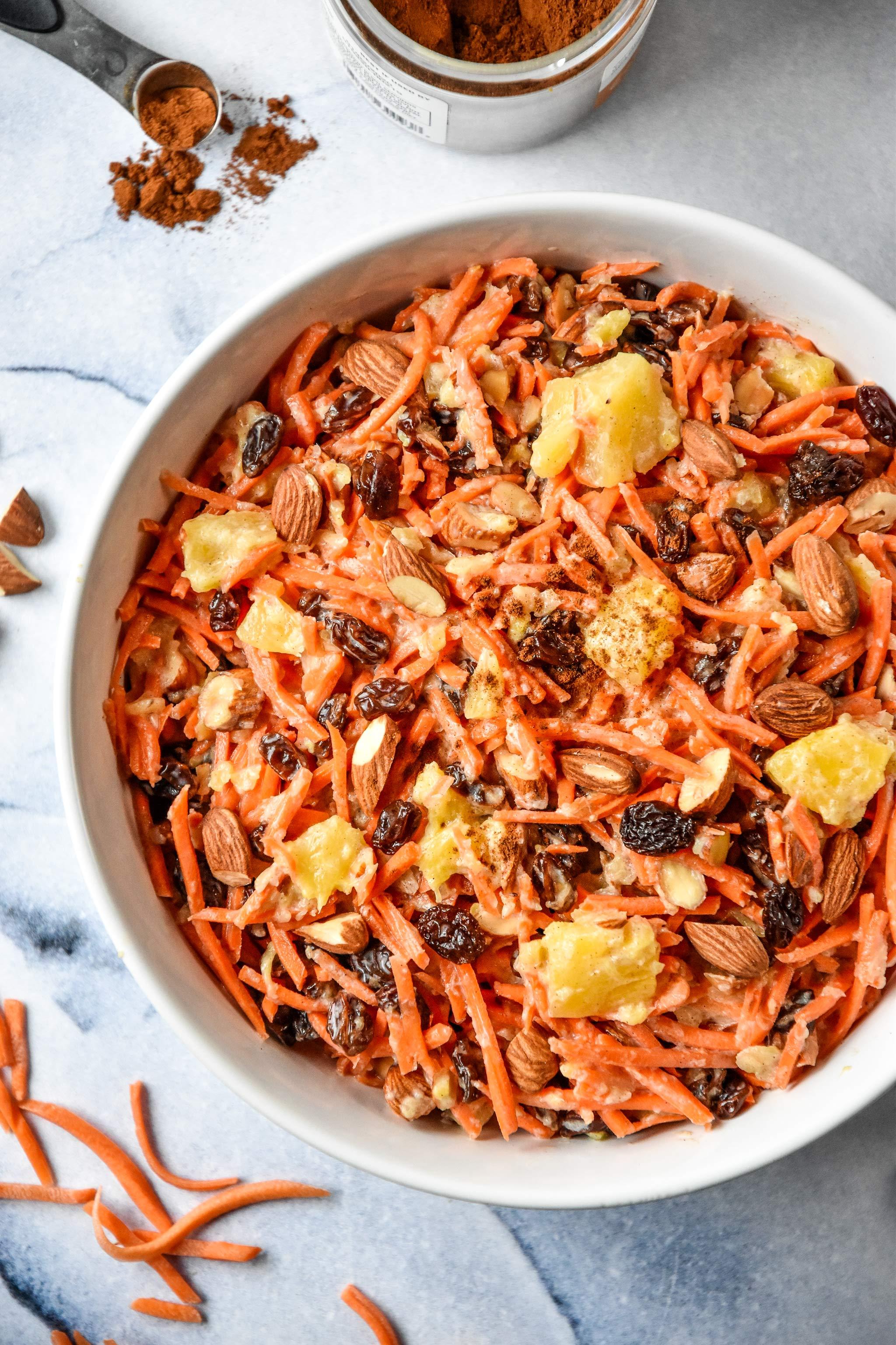 cinnamon raisin carrot salad in a white bowl