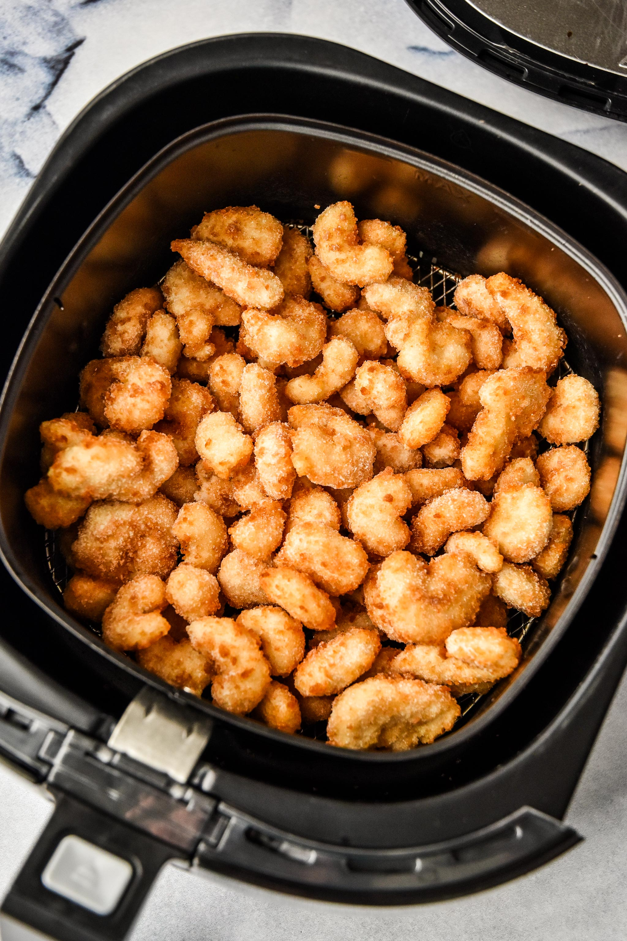 about to cook frozen breaded shrimp in an air fryer
