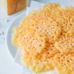 baked parmesan crisps on a plate lined with a paper towel