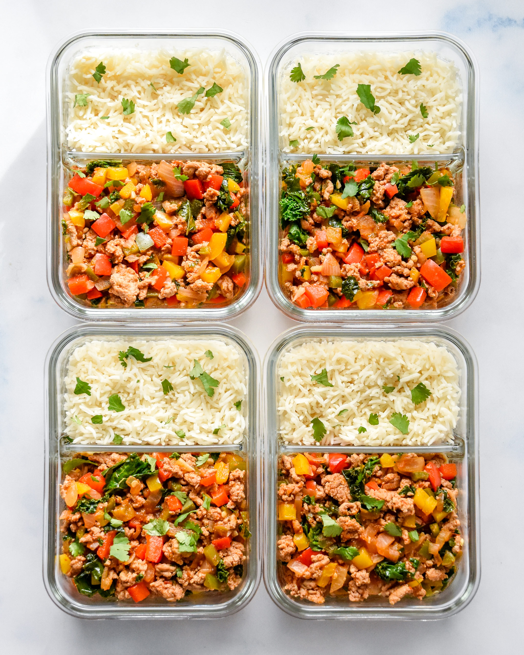 chipotle ground turkey skillet meal prep with rice in containers