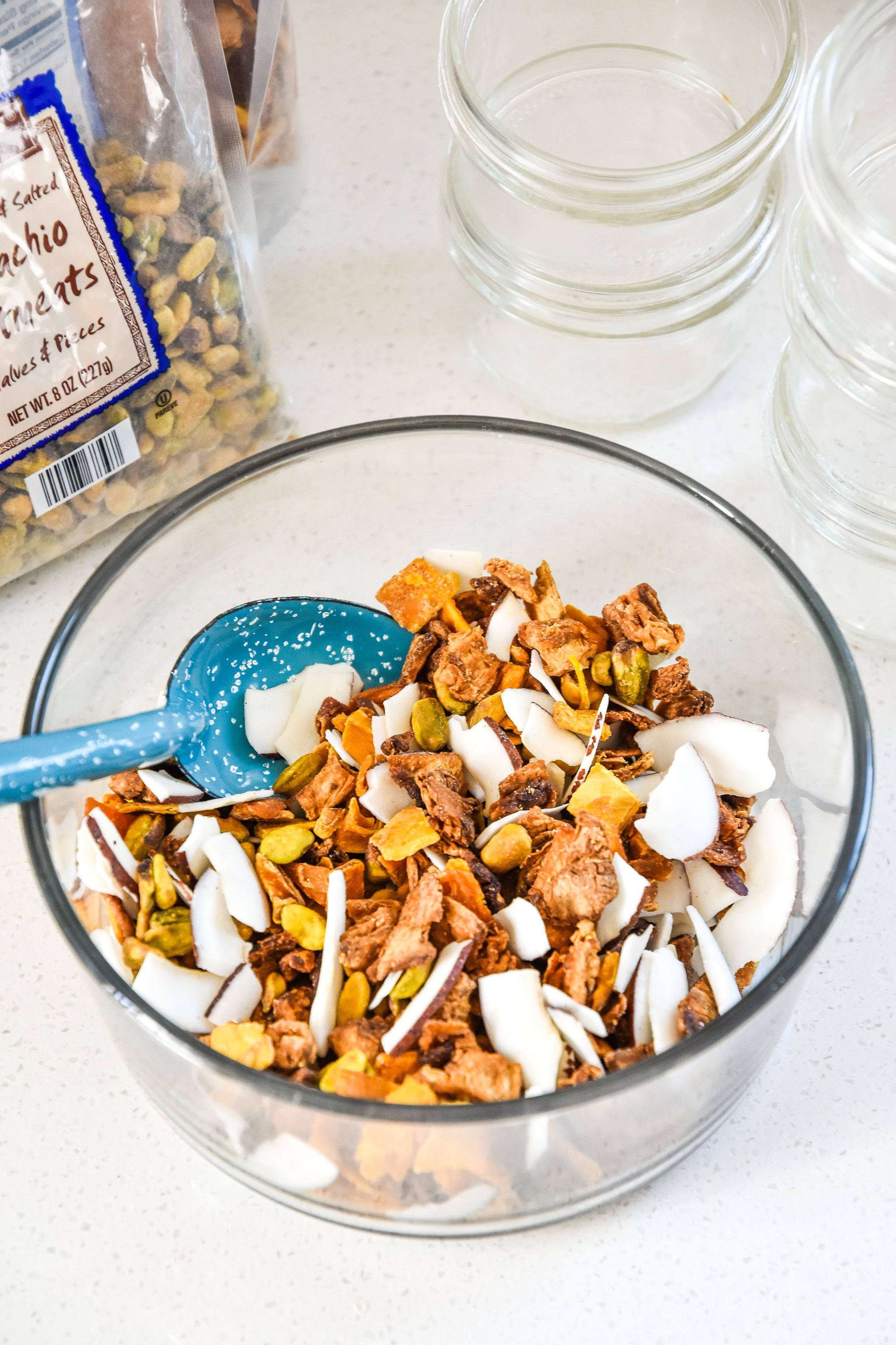 the tropical dried fruit trail mix after being mixed up in a bowl