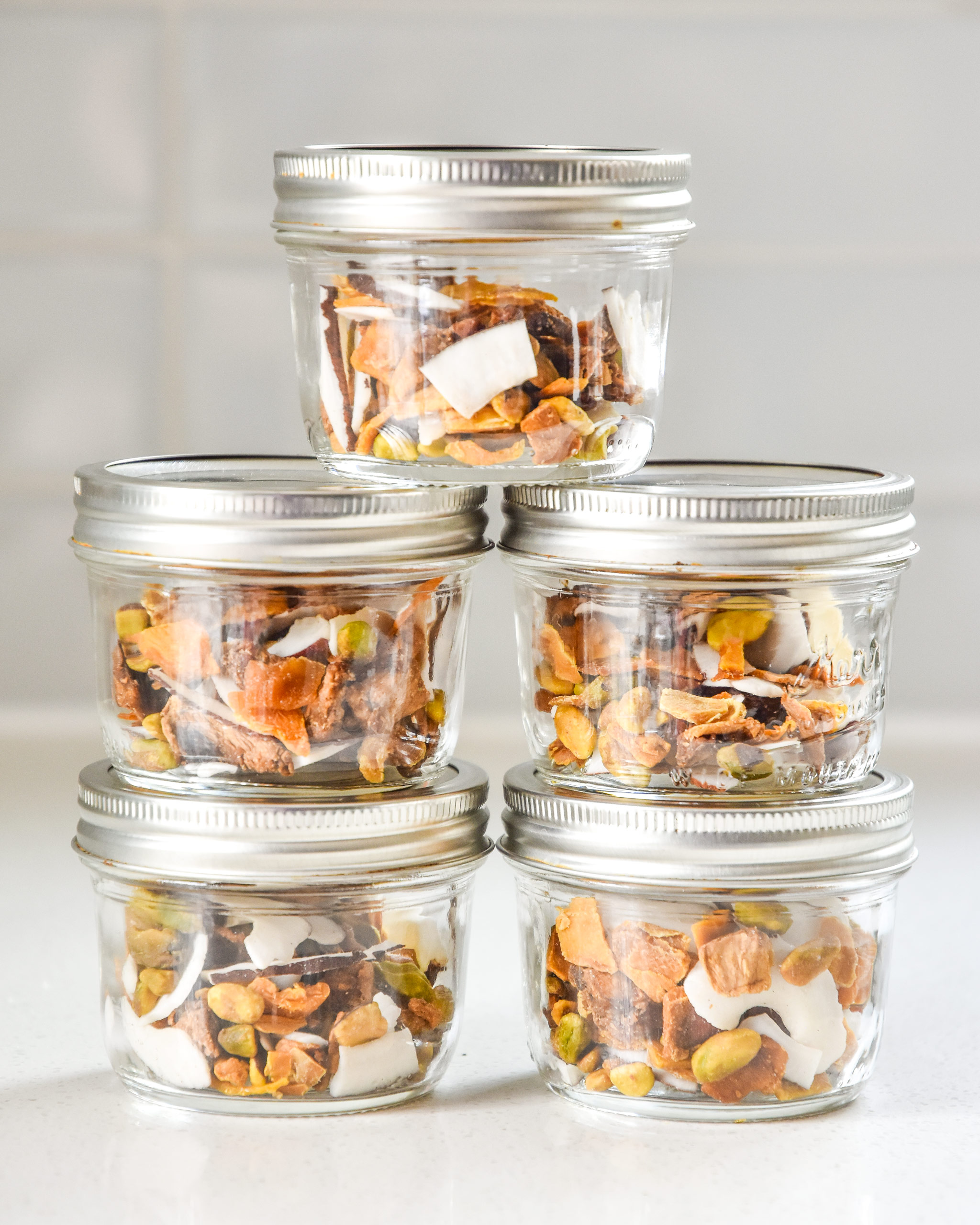 tropical dried fruit trail mix in stacked mason jars