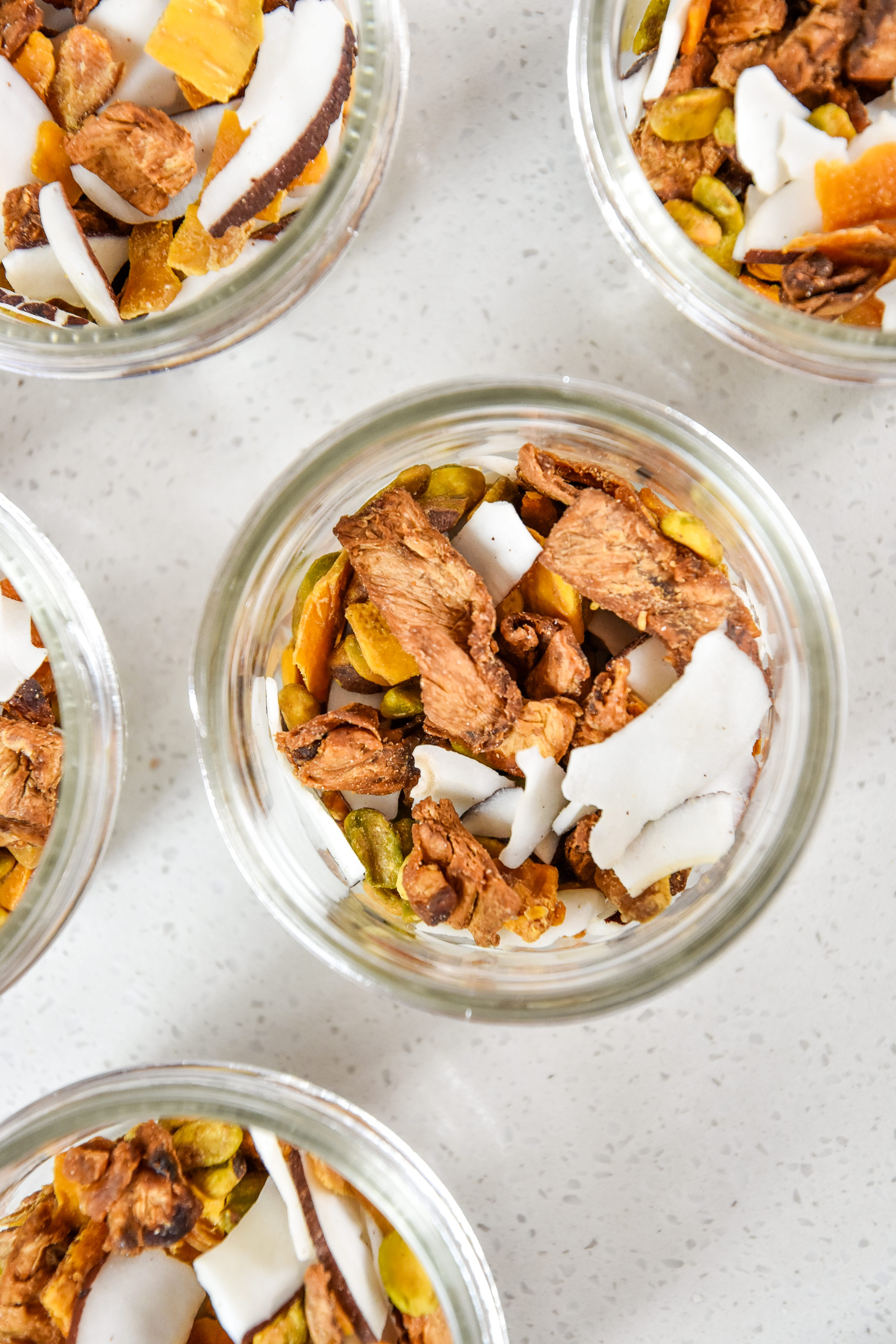 tropical dried fruit trail mix portioned into mason jars for snacks