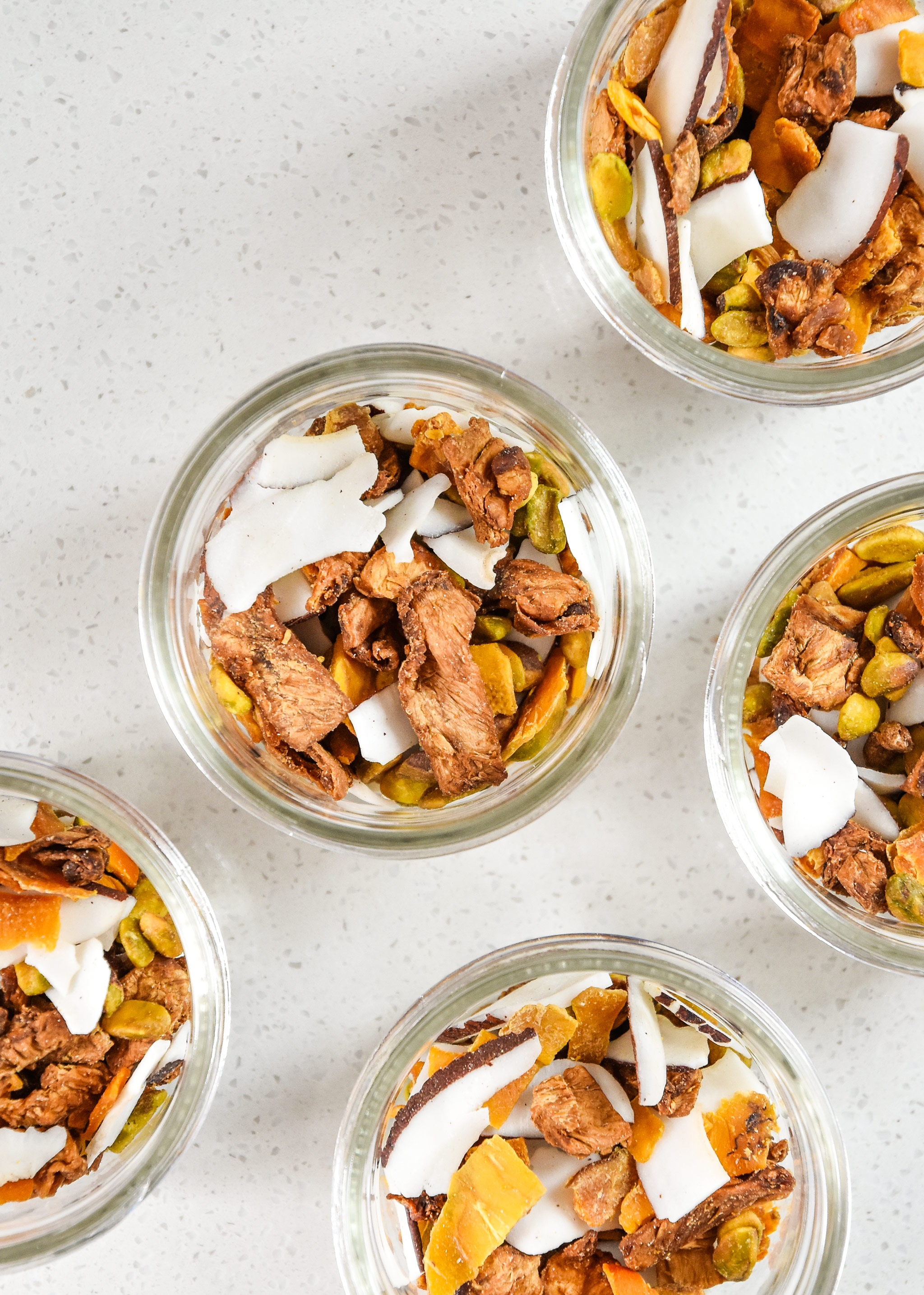 jars of tropical dried fruit trail mix portioned for snacks