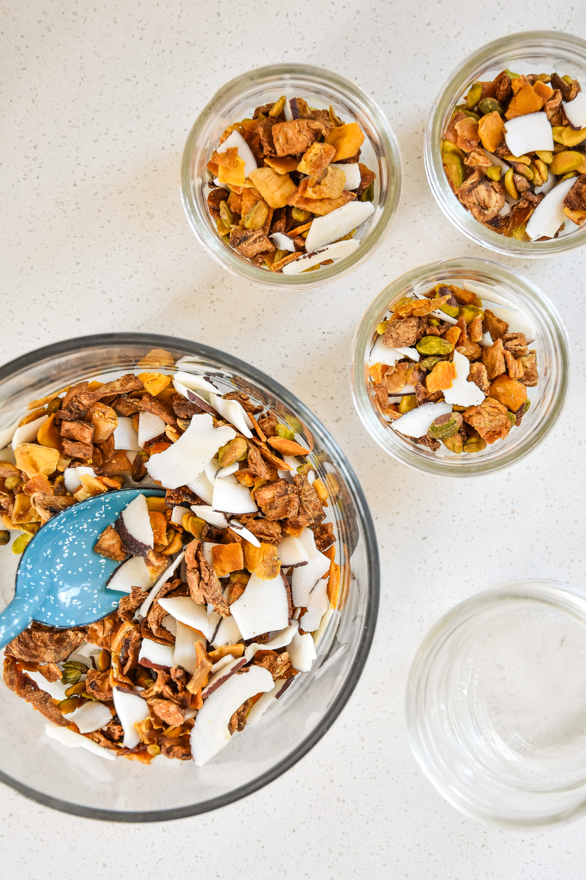 portioning out the tropical dried fruit trail mix