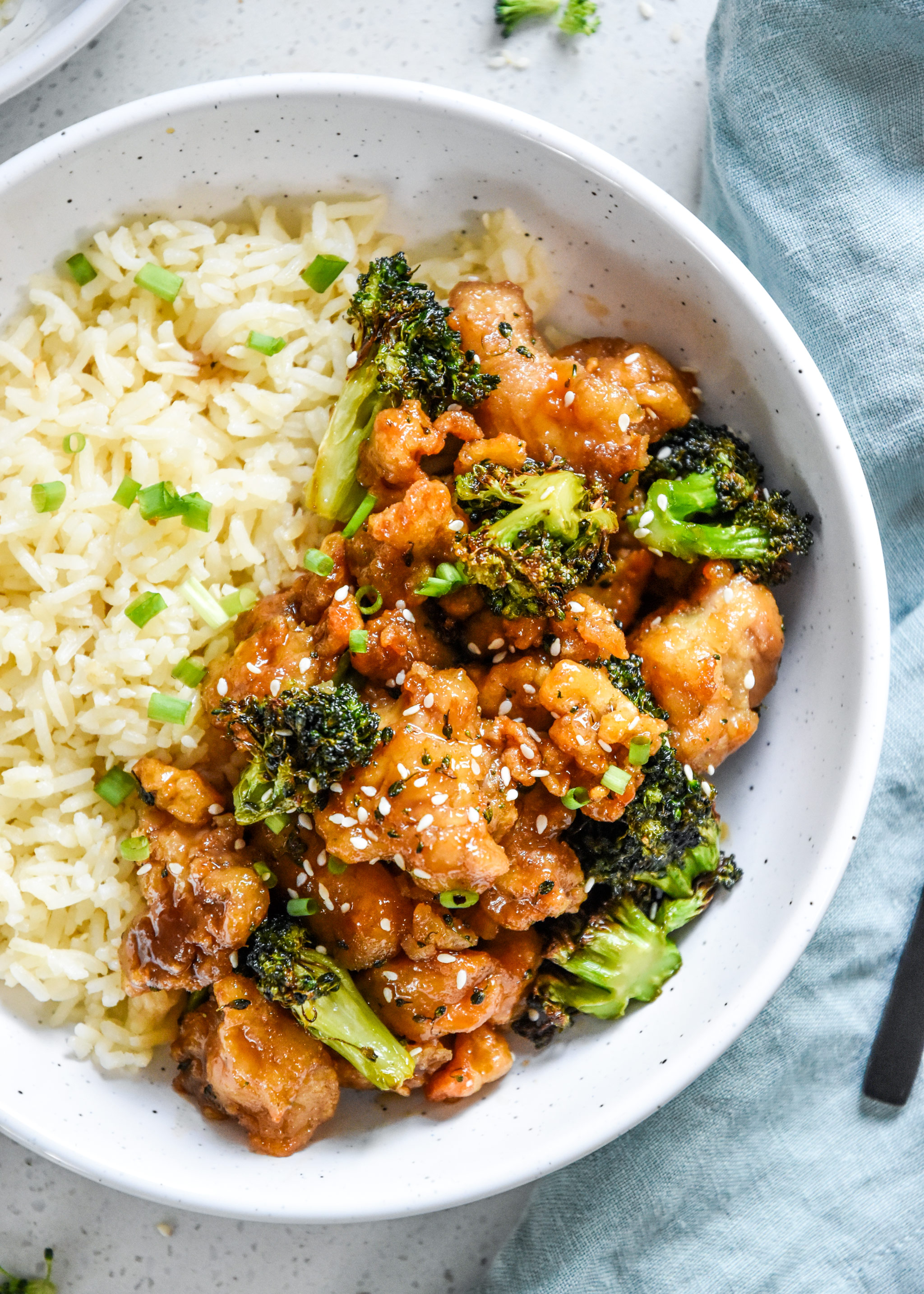air fryer trader joes orange chicken and broccoli dinner plated with rice