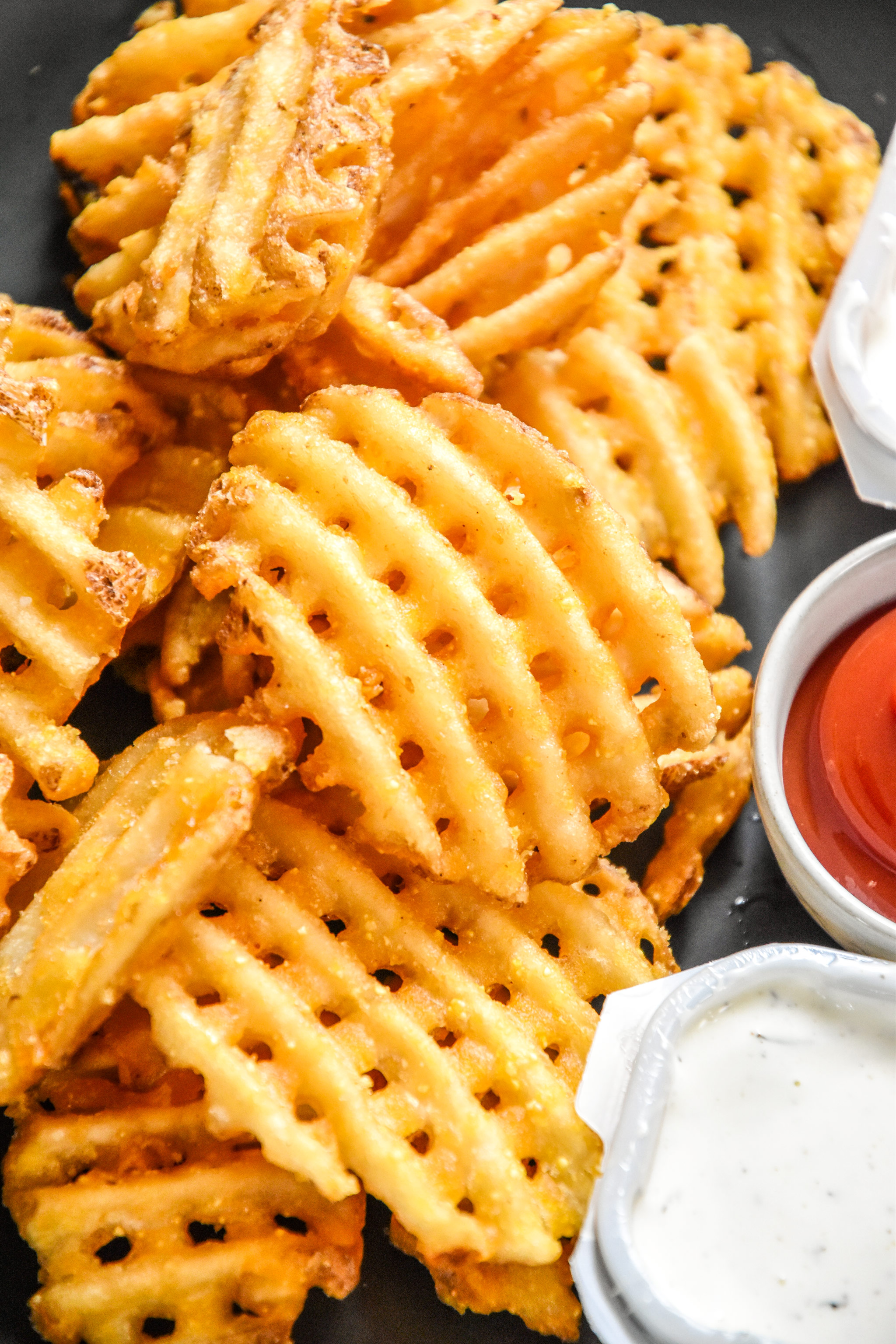 close up of waffle fries reheated in an air fryer