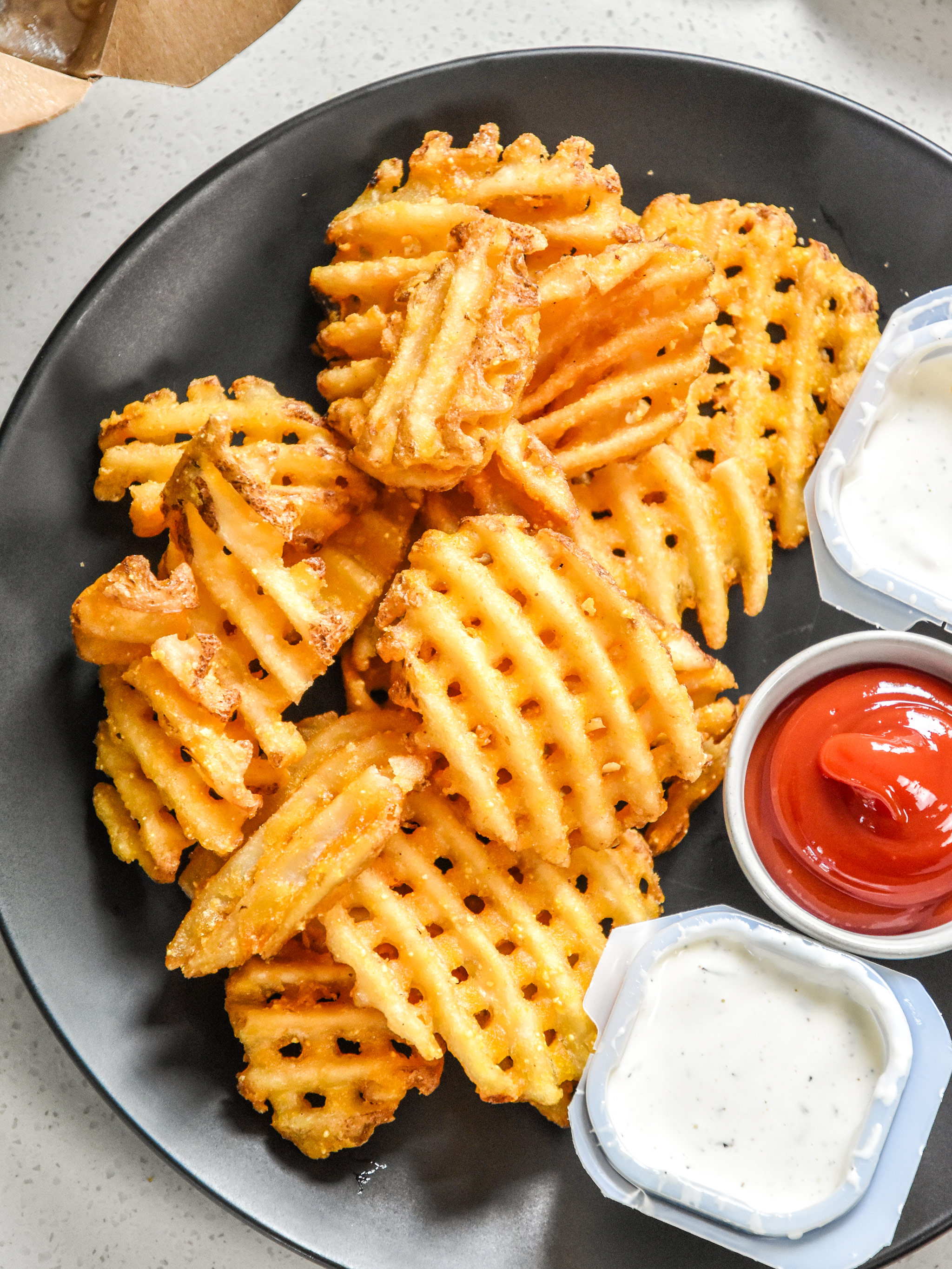 how to reheat fries in an air fryer on a plate served with sauce